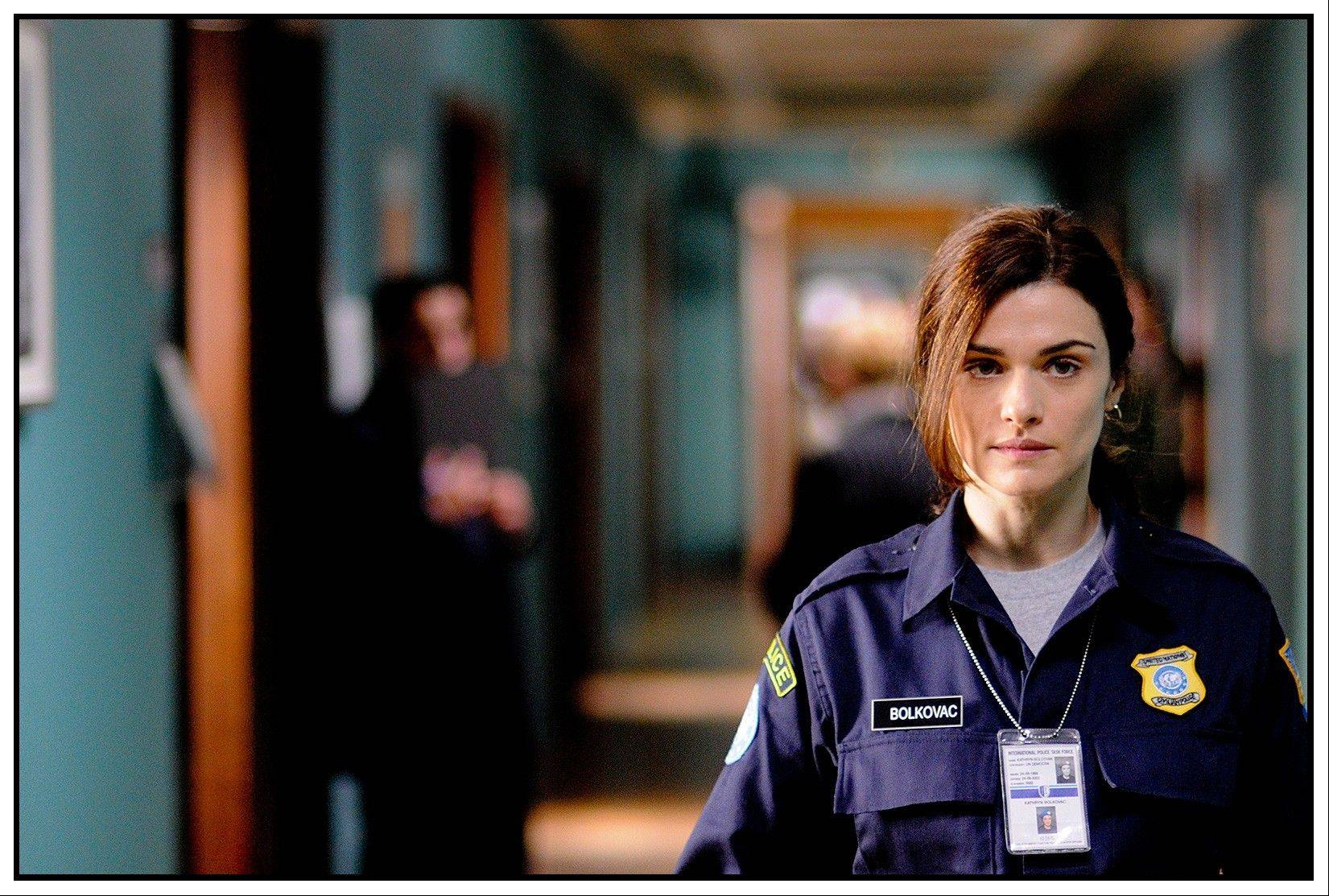 "A Nebraska cop (Rachel Weisz) becomes a U.N. peacekeeper who uncovers a conspiracy to traffic sex slaves in the fact-based drama ""The Whistleblower."""
