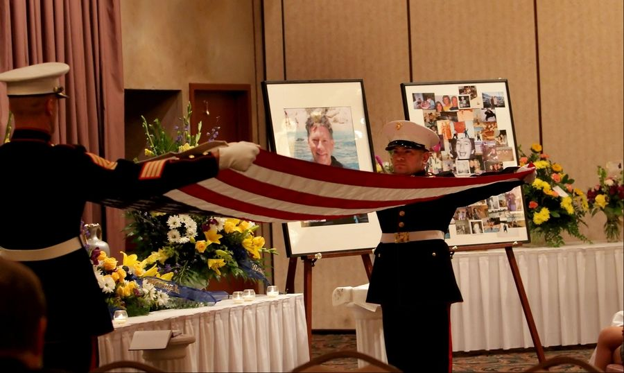 Members of the U.S. Marine Corps Reserve Center in Joliet perform military funeral honors during a memorial ceremony Thursday in Willowbrook for Randy Suchy of Naperville who died Friday helping to save a 12-year-old boy from drowning.