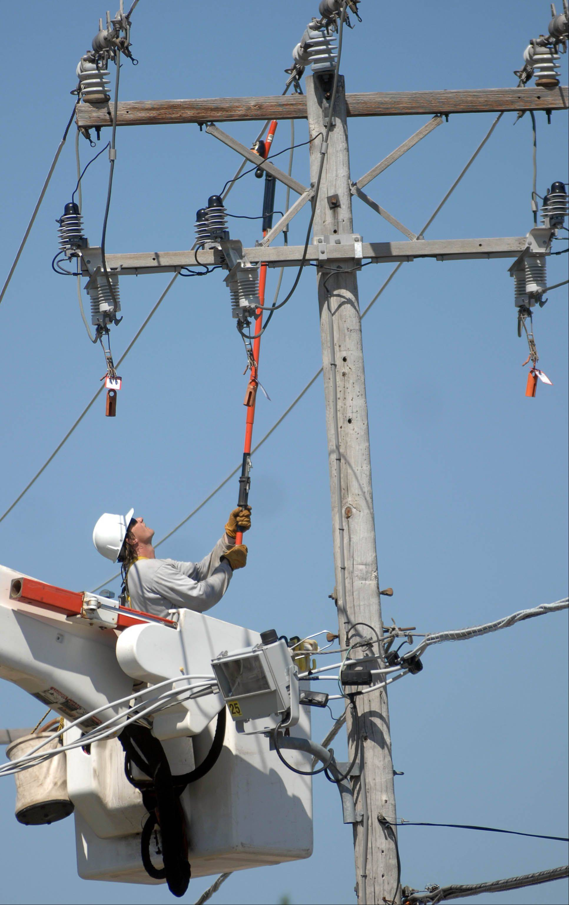 ComEd crews work to restore power in Lake County following one of the summer storms.