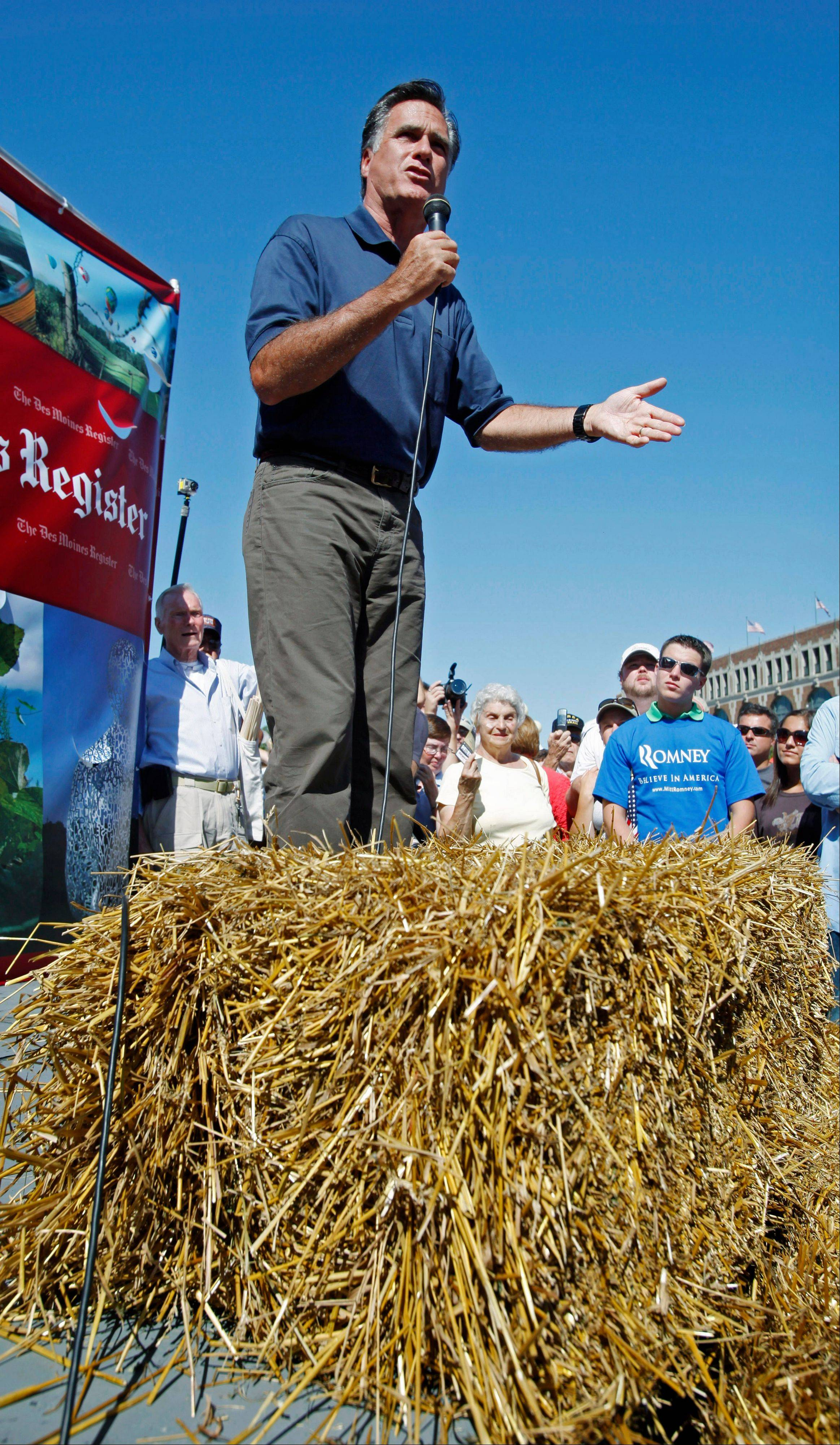 Former Mass. Gov. Mitt Romney speaks to fair goers during a campaign stop at the Iowa State Fair in Des Moines on Thursday.
