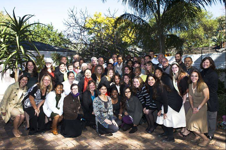 first lady Michelle Obama, in the middle of the crowd, poses on June 24 with Peace Corps volunteers at the U.S. Ambassador's Residence in Gaborone, Botswana.