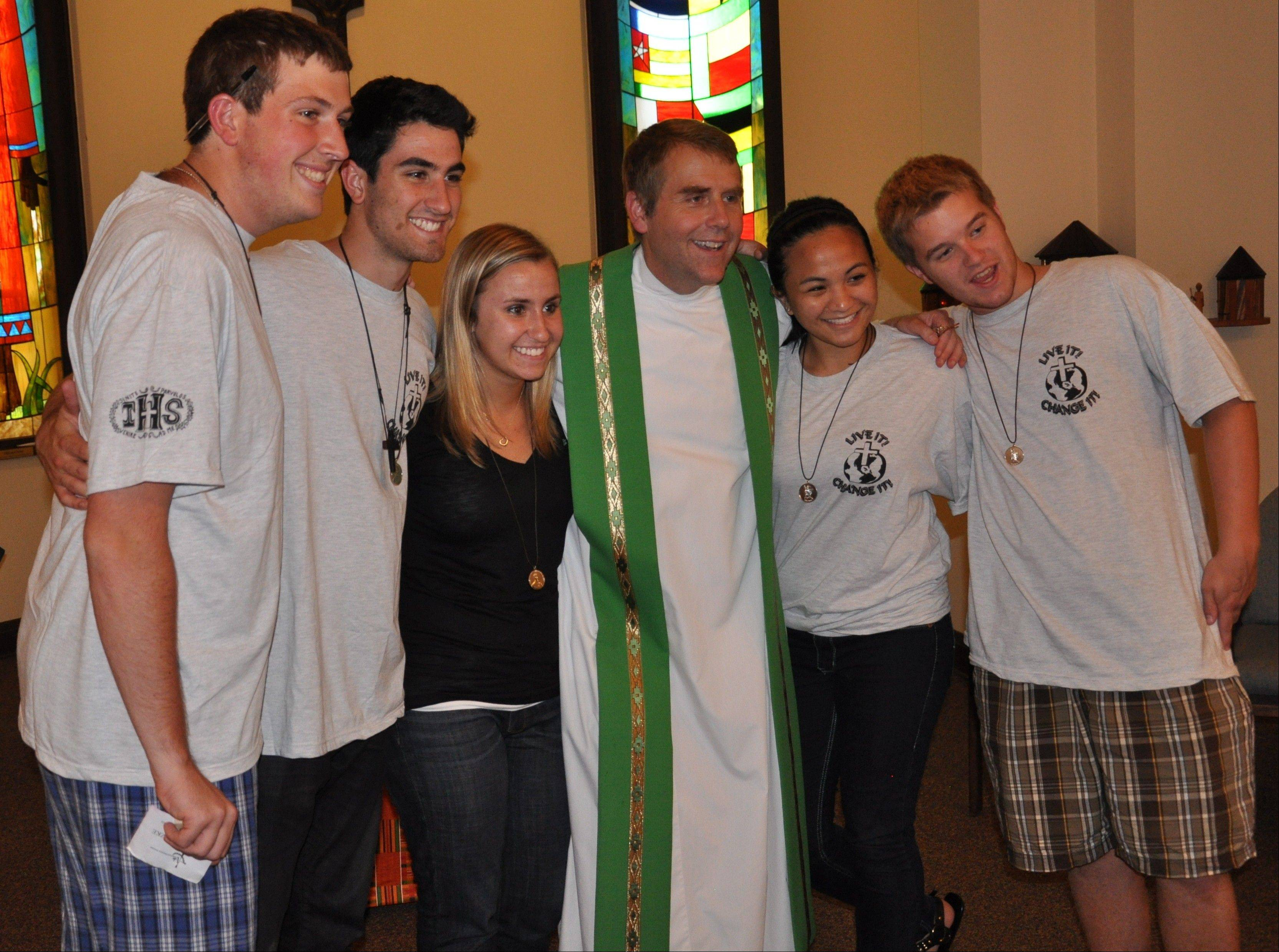 The Rev. Corey Brost, CSV, with student leaders from the congress after the closing Mass. Included, from left, are Steven Patzke of Arlington Heights, Nick Manfredi of Las Vegas, Lauren Drolet of Inverness, Cassie Esteban of Las Vegas and Tim Ivers of Arlington Heights.