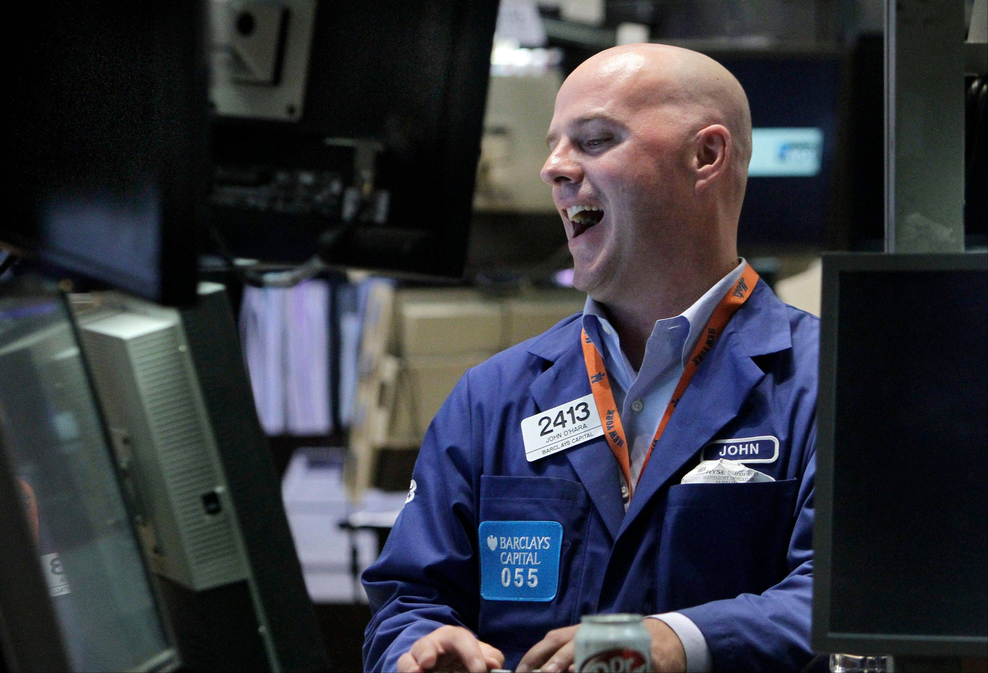Specialist John O�Hara smiles Friday as he works at his post on the floor of the New York Stock Exchange. Is it because it�s been more than a month the markets finished up for a second day in a row?