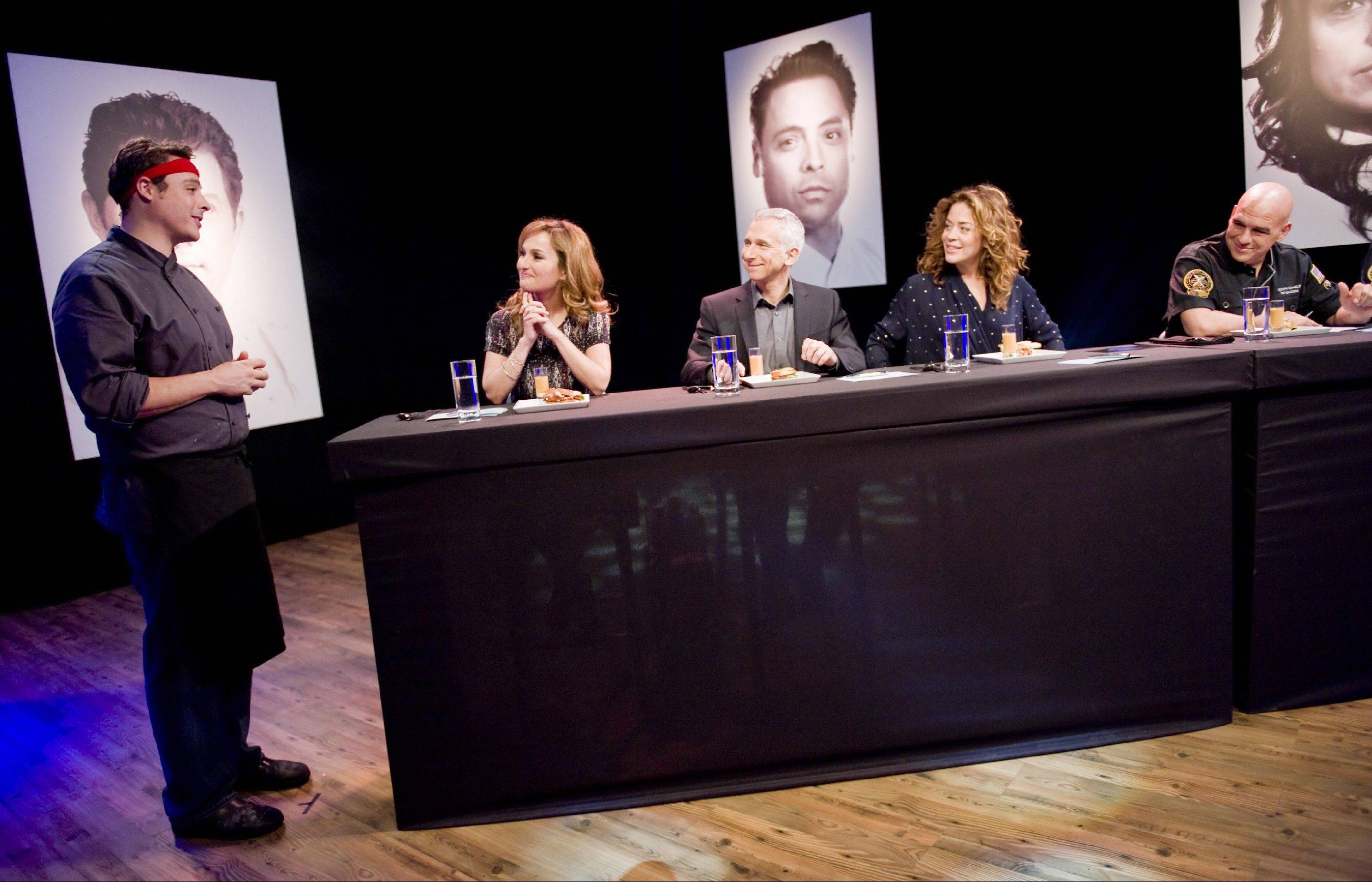 "Contestant Jeff Mauro, a chef from Chicago, presents to judges Giada De Laurentiis, Bob Tuschman, Susie Fogelson and Iron Chef Michael Simon during an episode of ""Food Network Star."""