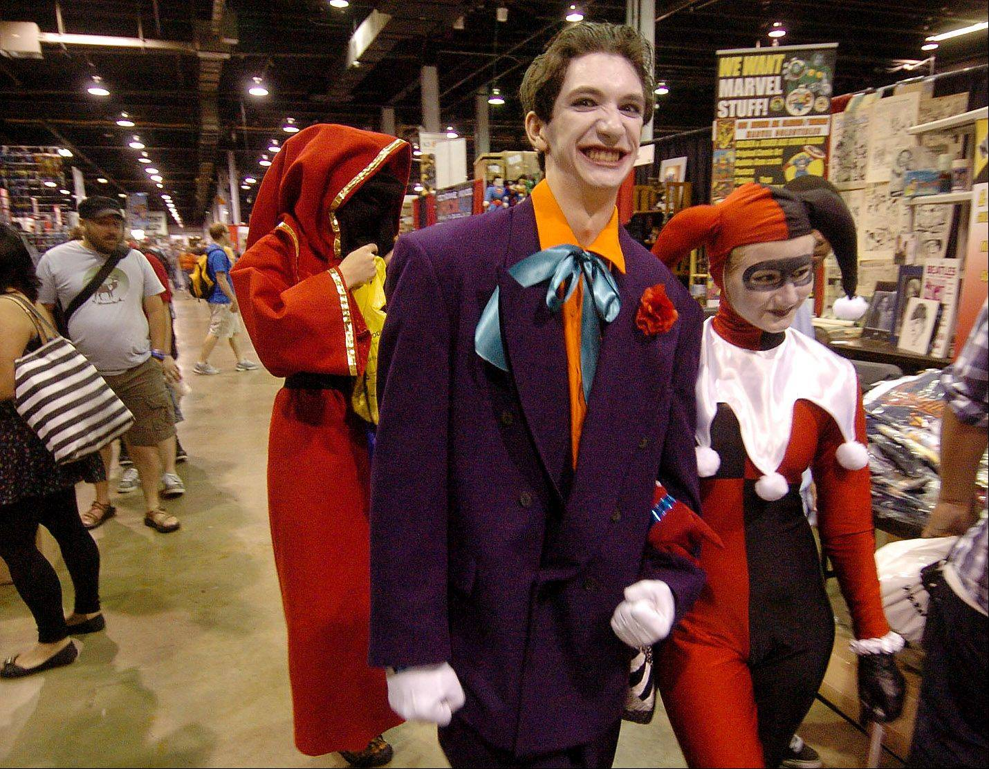 Alex Midlash of Hinsdale as the Joker and Grace Gill of Clarendon Hills as Harley Quinn roam the Wizard World Chicago Comic Con.
