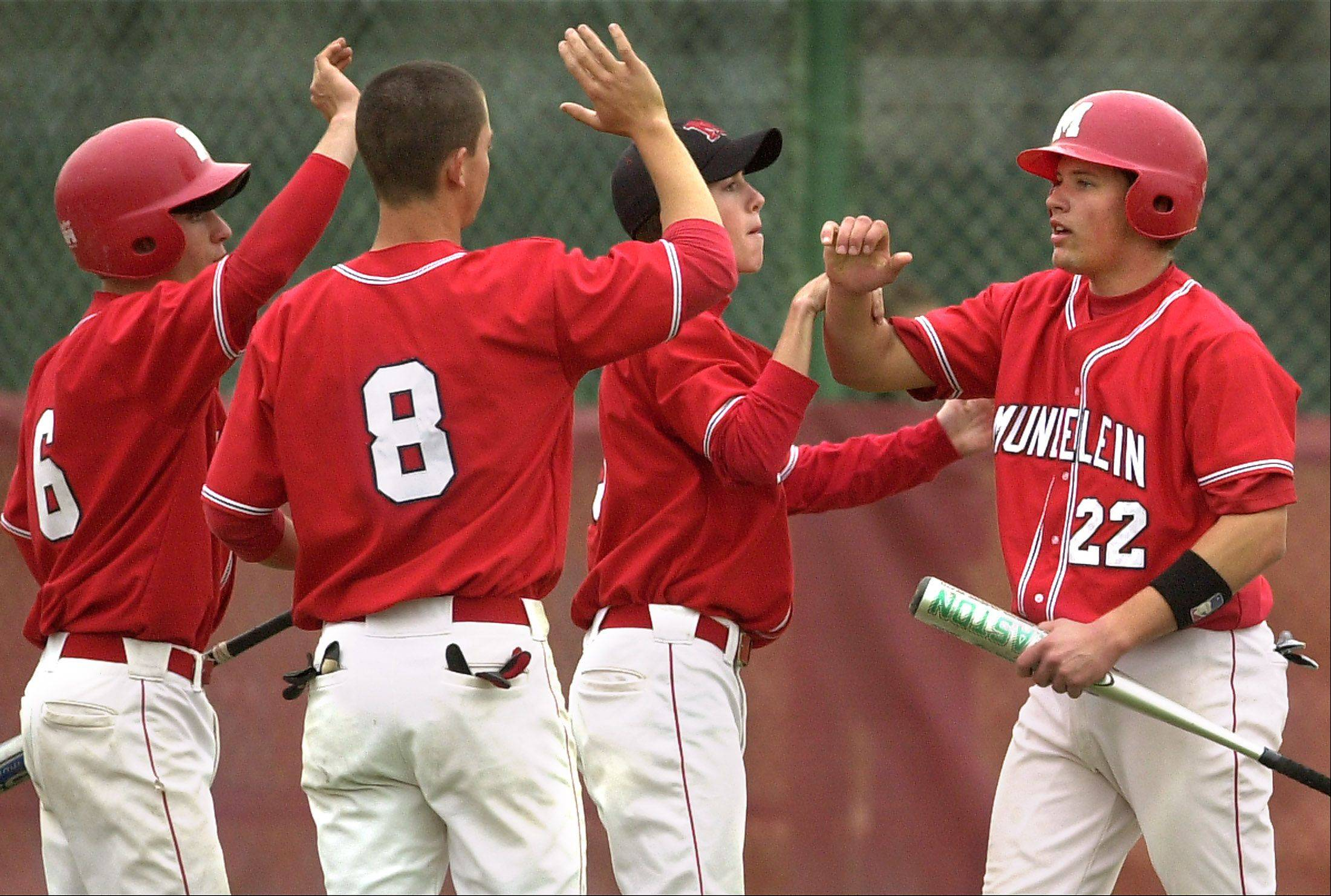 PAUL VALADE/Daily Herald File Photo The booster club for the Mundelein High School baseball team is among those that could be consolidated into one group.