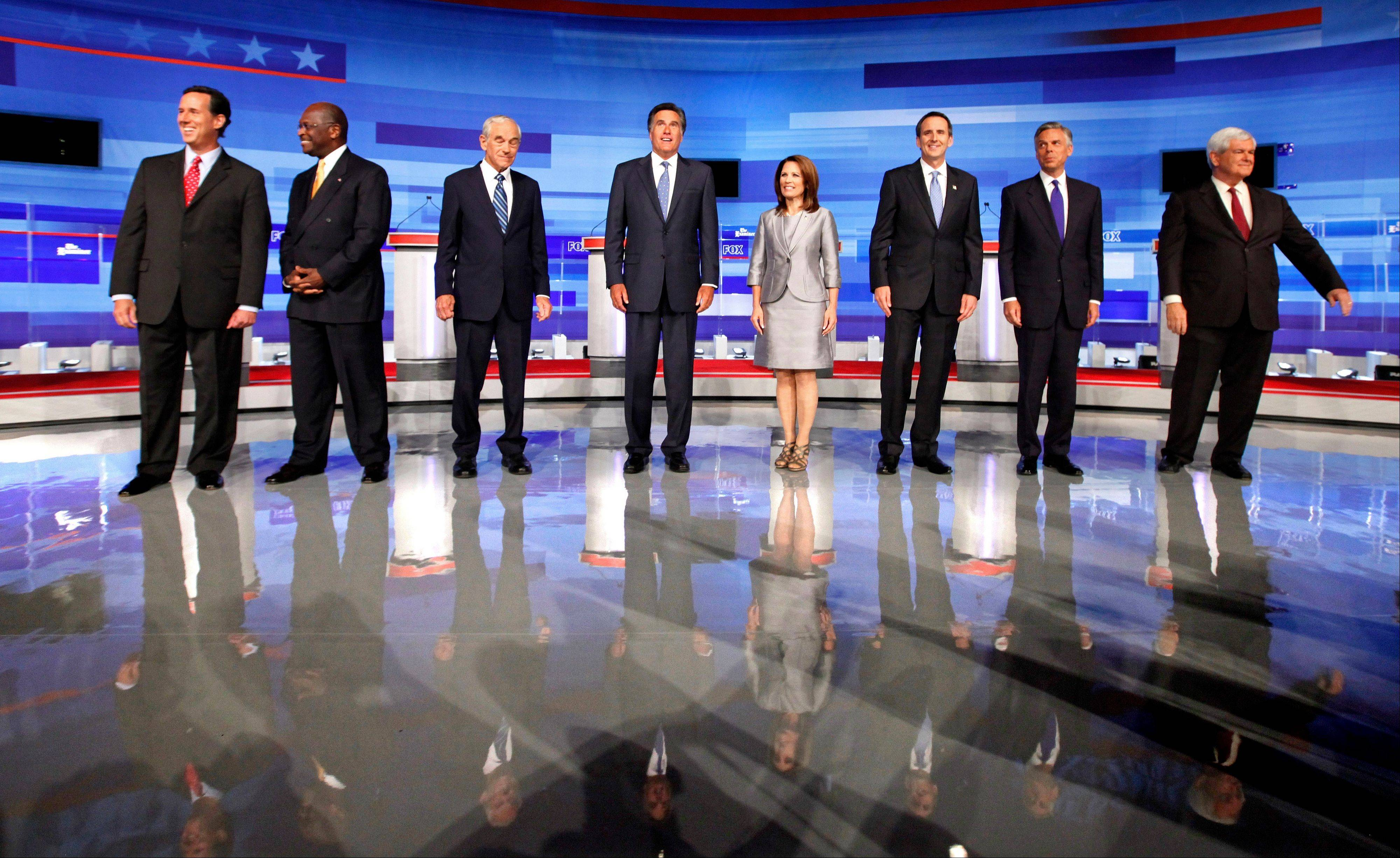 Republican presidential candidates former Pennsylvania Sen. Rick Santorum, from left, businessman Herman Cain, Rep. Ron Paul, R-Texas, former Massachusetts Gov. Mitt Romney, Rep. Michele Bachmann, R-Minn., former Minnesota Governor Tim Pawlenty, former Utah Gov. Jon Huntsman, and former House Speaker Newt Gingrich.