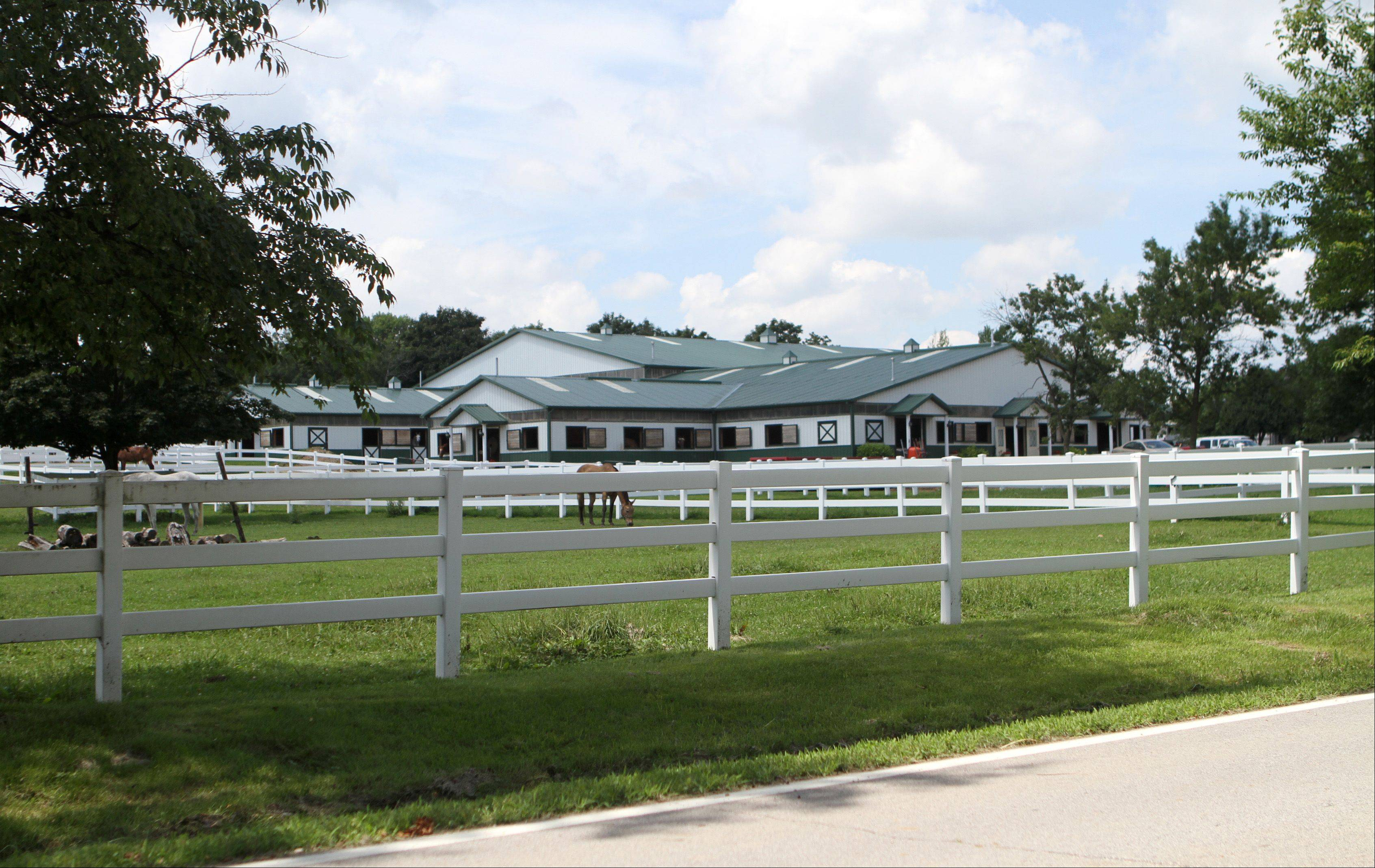 Oakwood Farms, as seen from Bateman Road in Barrington Hills. A new lawsuit has been filed accusing village officials of taking part in a �pay to play� scheme to make the commercial boarding of up to 60 horses there legal.