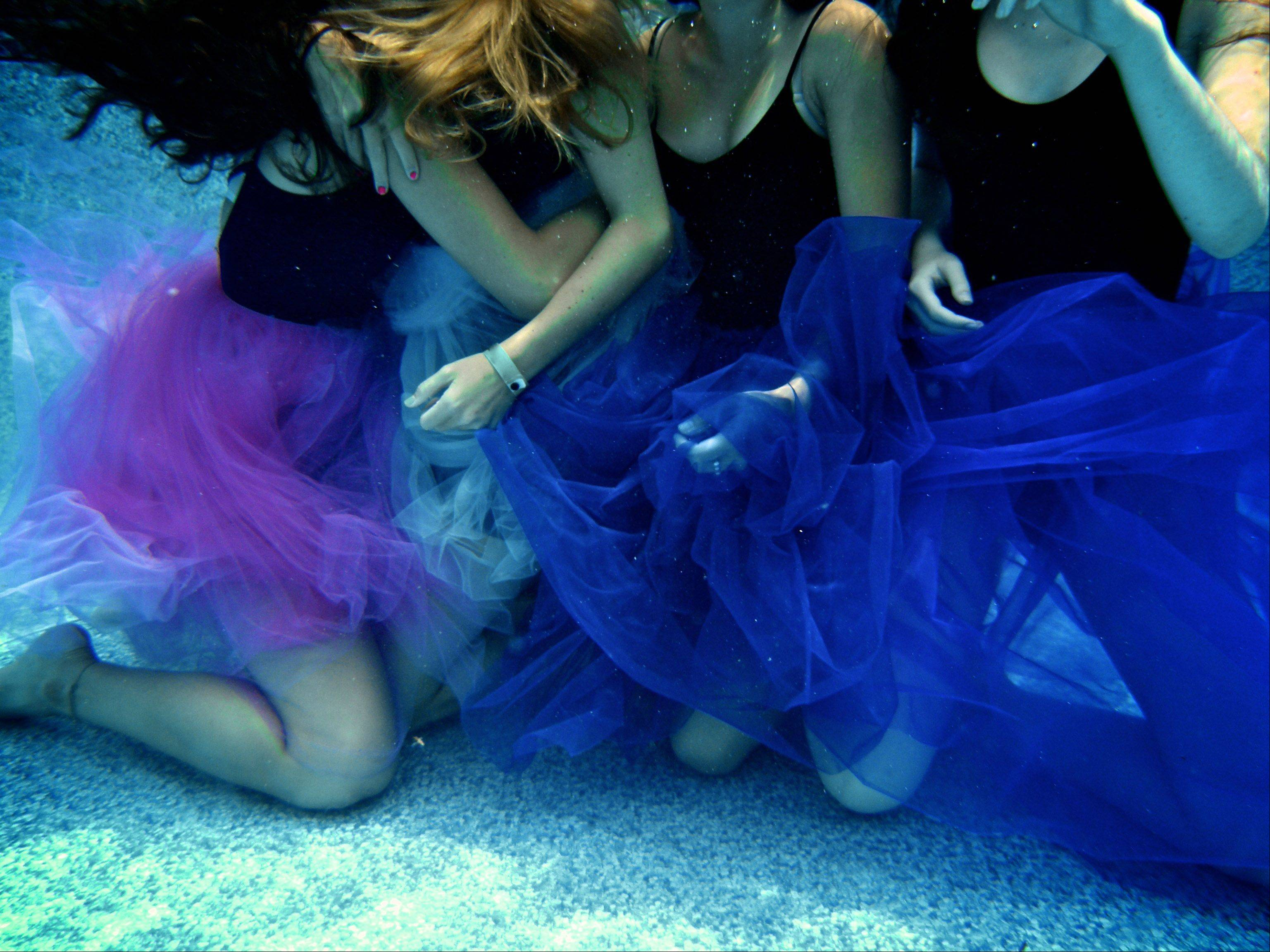 Several girls wear tutus as they are photographed underwater while they float in a swimming pool in Mundelein.