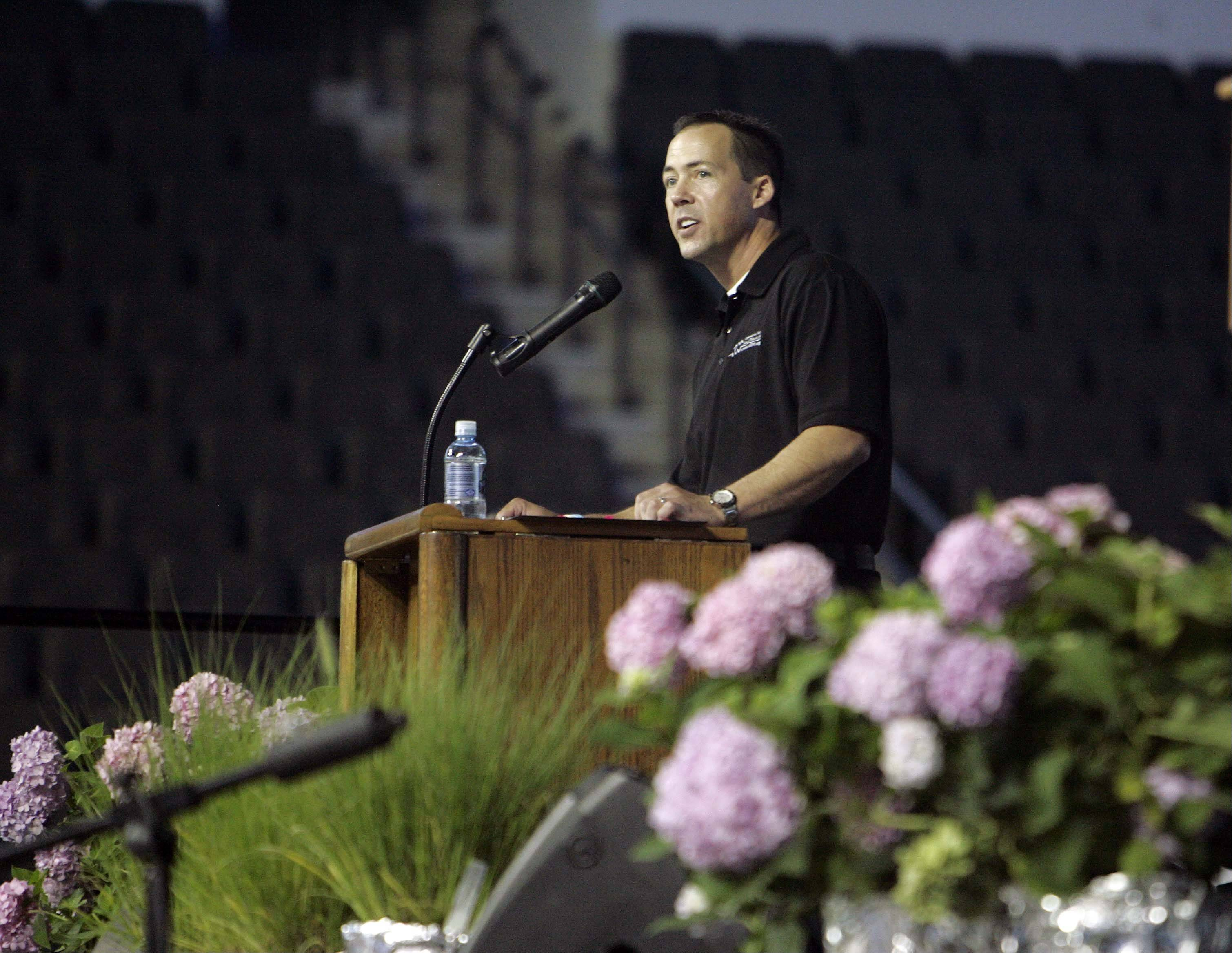 Community Unit District 300 Superintendent Michael Bregy leads more than 3,000 district staff members Friday in a back-to-school rally at the Sears Centre in Hoffman Estates.