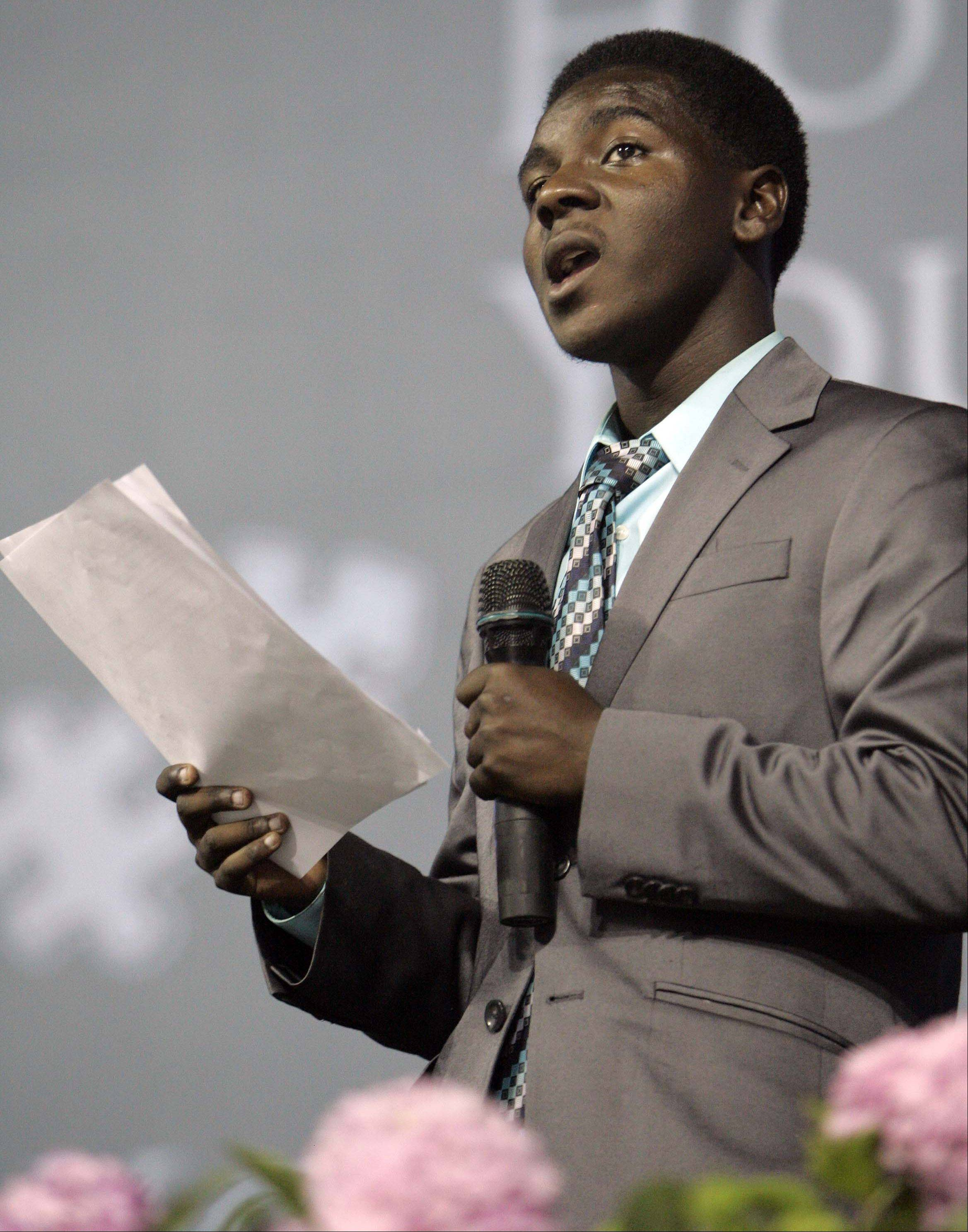 "Korvell Branch delivers his ""How do you fit"" speech to more than 3,000 district staff members Friday at a back-to-school rally at the Sears Centre in Hoffman Estates. Branch, a 2011 District 300 graduate, will be the first of his family to attend college."