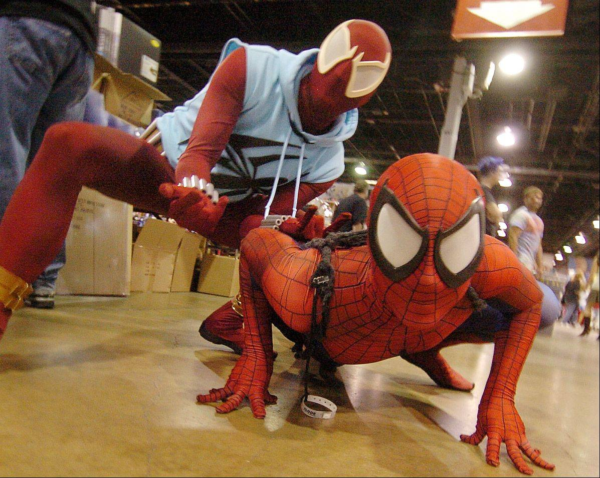 Bill Higa, left, from Palatine, as the Scarlet Siderman, and Paul Heid of Chicago as Spiderman, make their rounds at the Wizard World Chicago Comic Con.