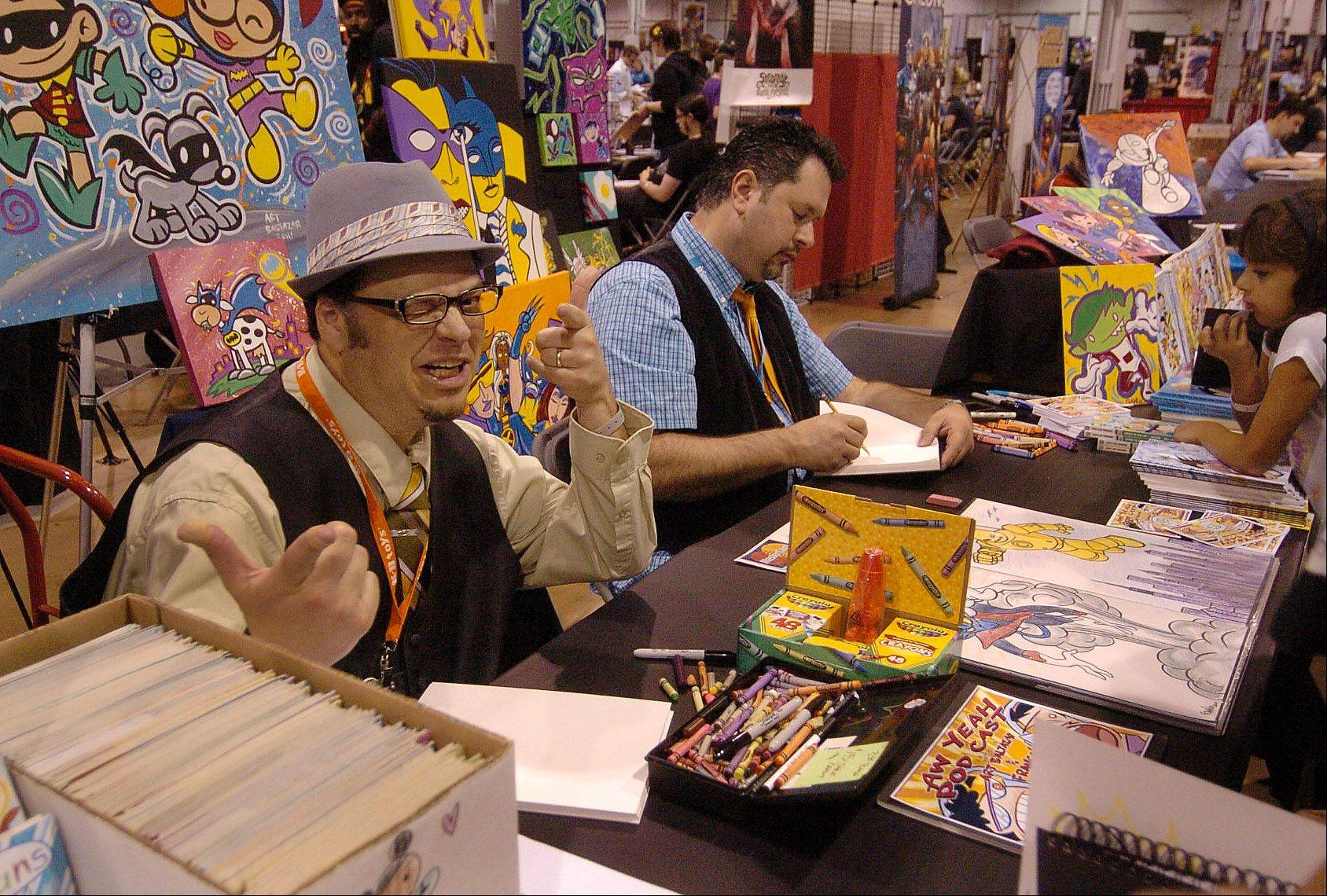 Comic Book artist Art Balthazar from Streamwood, signing some os his work at the Wizard World Chicago Comic Con.