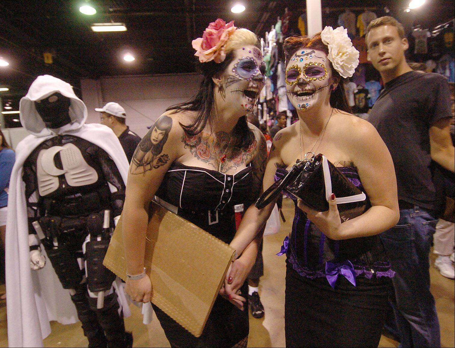 "Meghan Murder, left, and Clarissa Coffin, both of Chicago, peddle their wares called ""Murder Pinups"" at the Wizard World Chicago Comic Con."