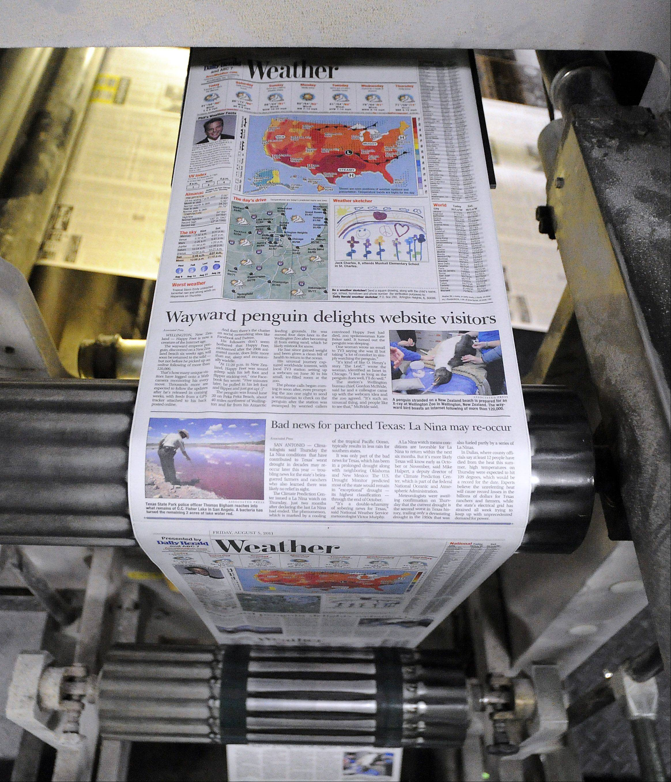 The crisp, colorful pages of the Daily Herald newspaper roll off the press.