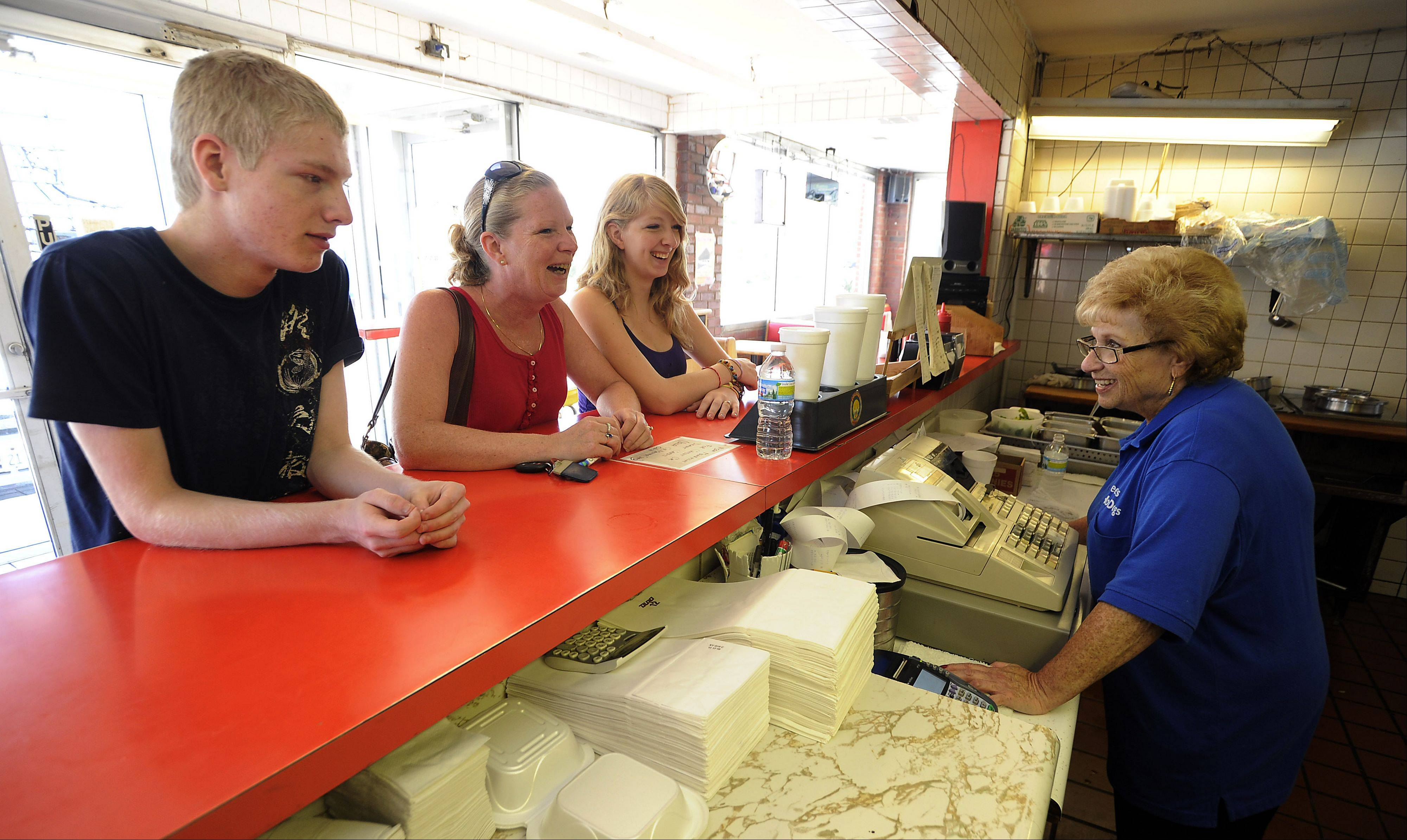 Owner Sharon Rossman is closing Peep's Hot Dogs near Hersey High School. Cindy Barnett and her daughter Laura, 16, and son, Mitch, 14, were disappointed Thursday to hear the news.