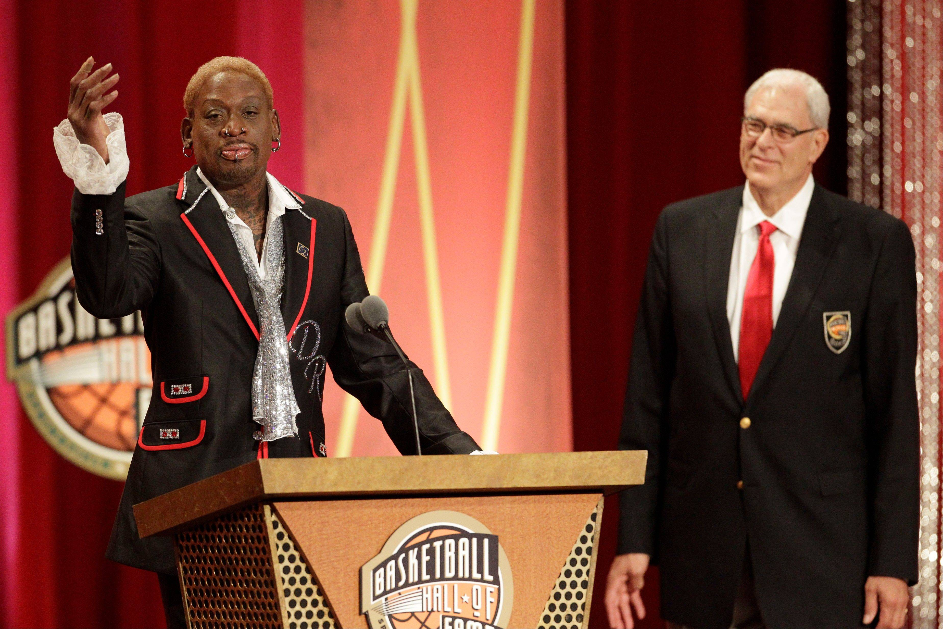 Dennis Rodman delivers his address at his Basketball Hall of Fame enshrinement during a ceremony as his former Bulls coach Phil Jackson looks on.