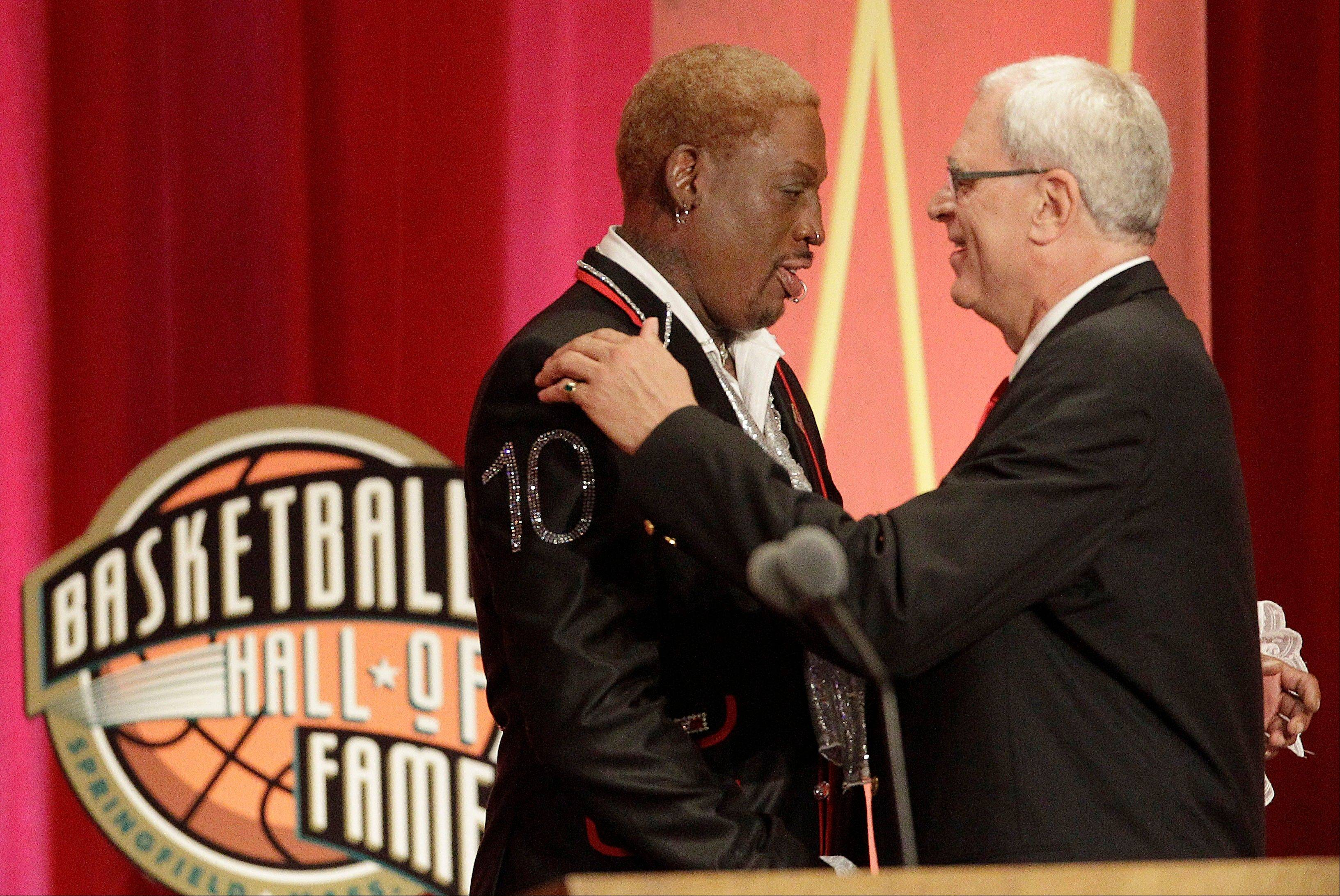 Dennis Rodman, left, is embraced by coach Phil Jackson at Rodman's Basketball Hall of Fame enshrinement.