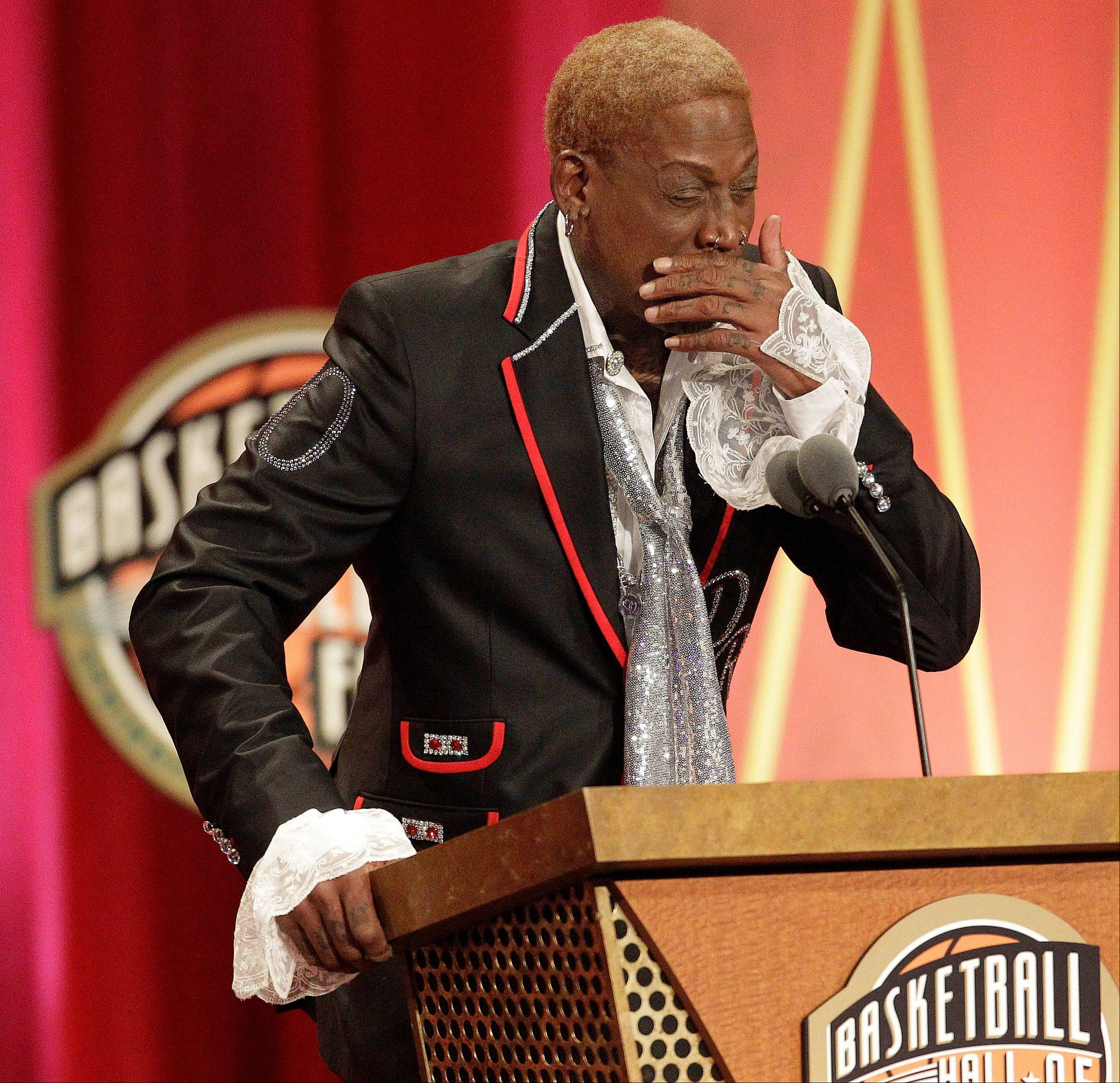Dennis Rodman becomes emotional during his address for his Basketball Hall of Fame enshrinement.