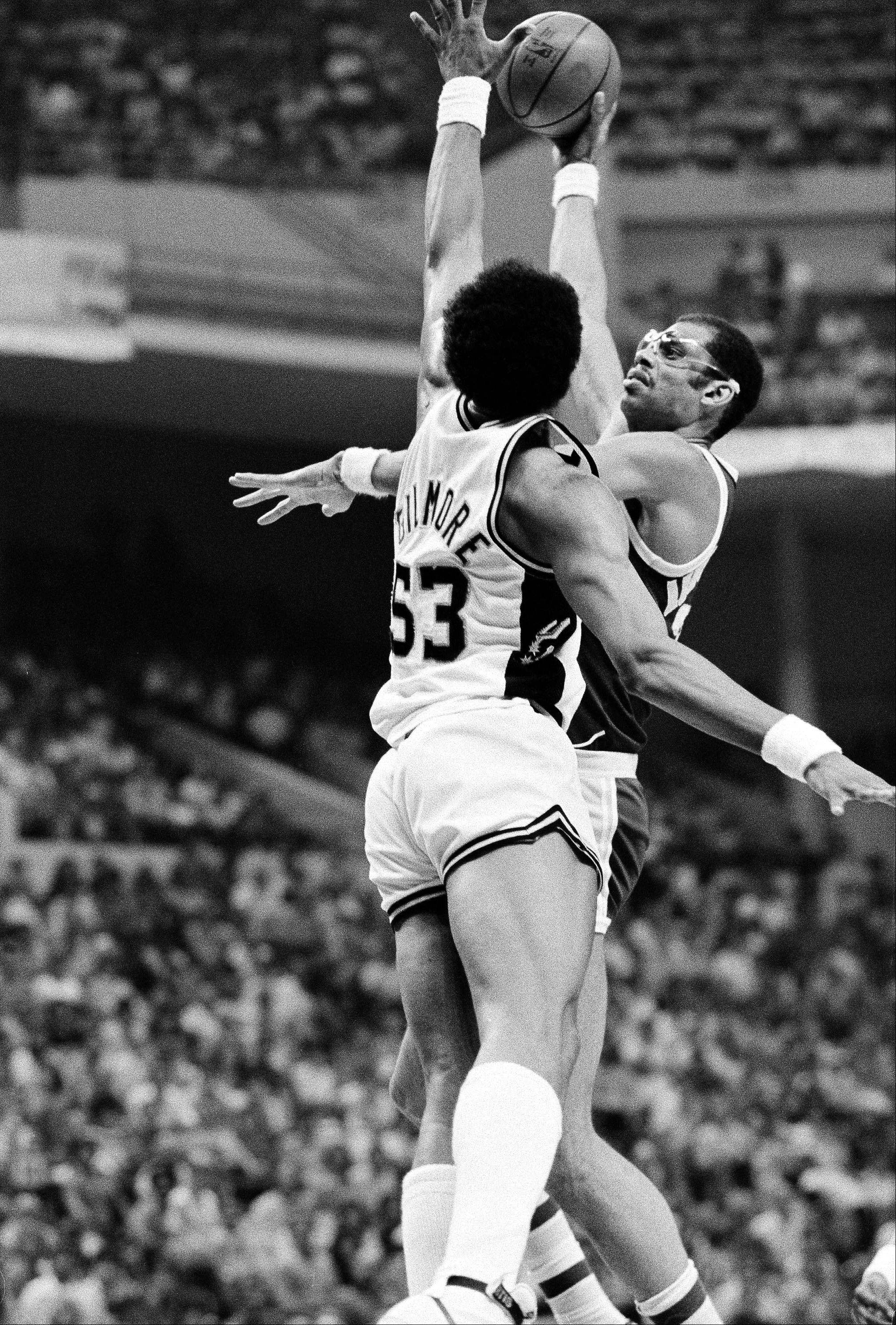 Kareem Abdul-Jabbar of the Los Angeles Lakers goes one on one against Artis Gilmore of the San Antonio Spurs on May 13, 1983 .