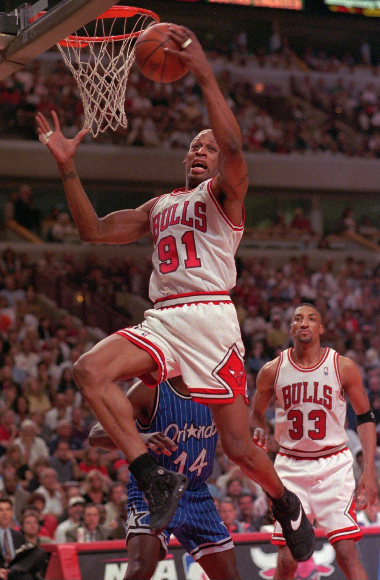 This May 19, 1996, file photo shows Chicago Bulls' forward Dennis Rodman grabbing one of his 21 rebounds during the fourth quarter of Game 1 of the NBA Eastern Conference Finals against the Orlando Magic, in Chicago.