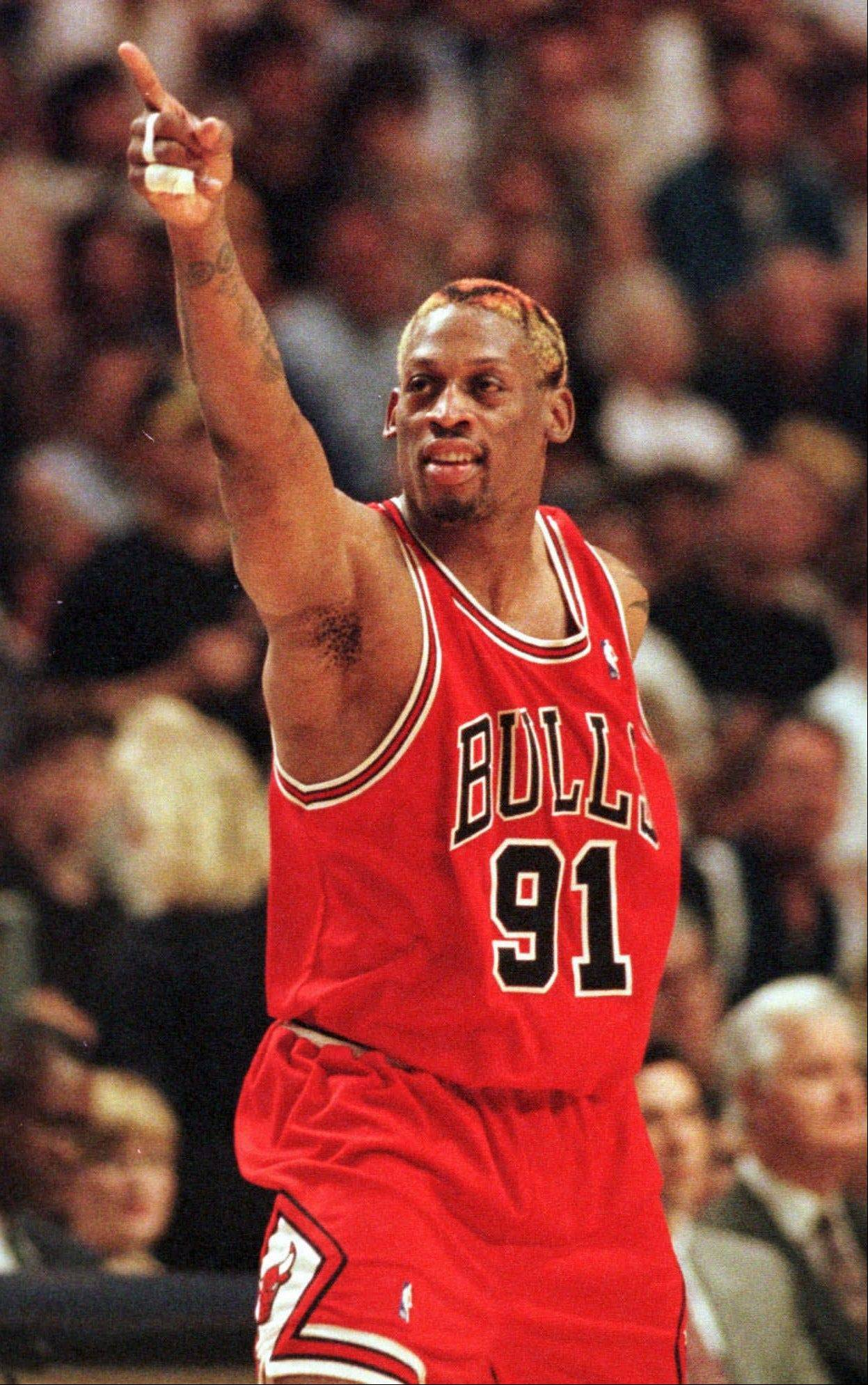 Chicago Bulls' Dennis Rodman points to the crowd during Game 4 of the Eastern Conference finals against the Indiana Pacers in Indianapolis, Monday, May 25, 1998. The Pacers beat the Bulls 96-94 to even the series at two games apiece.