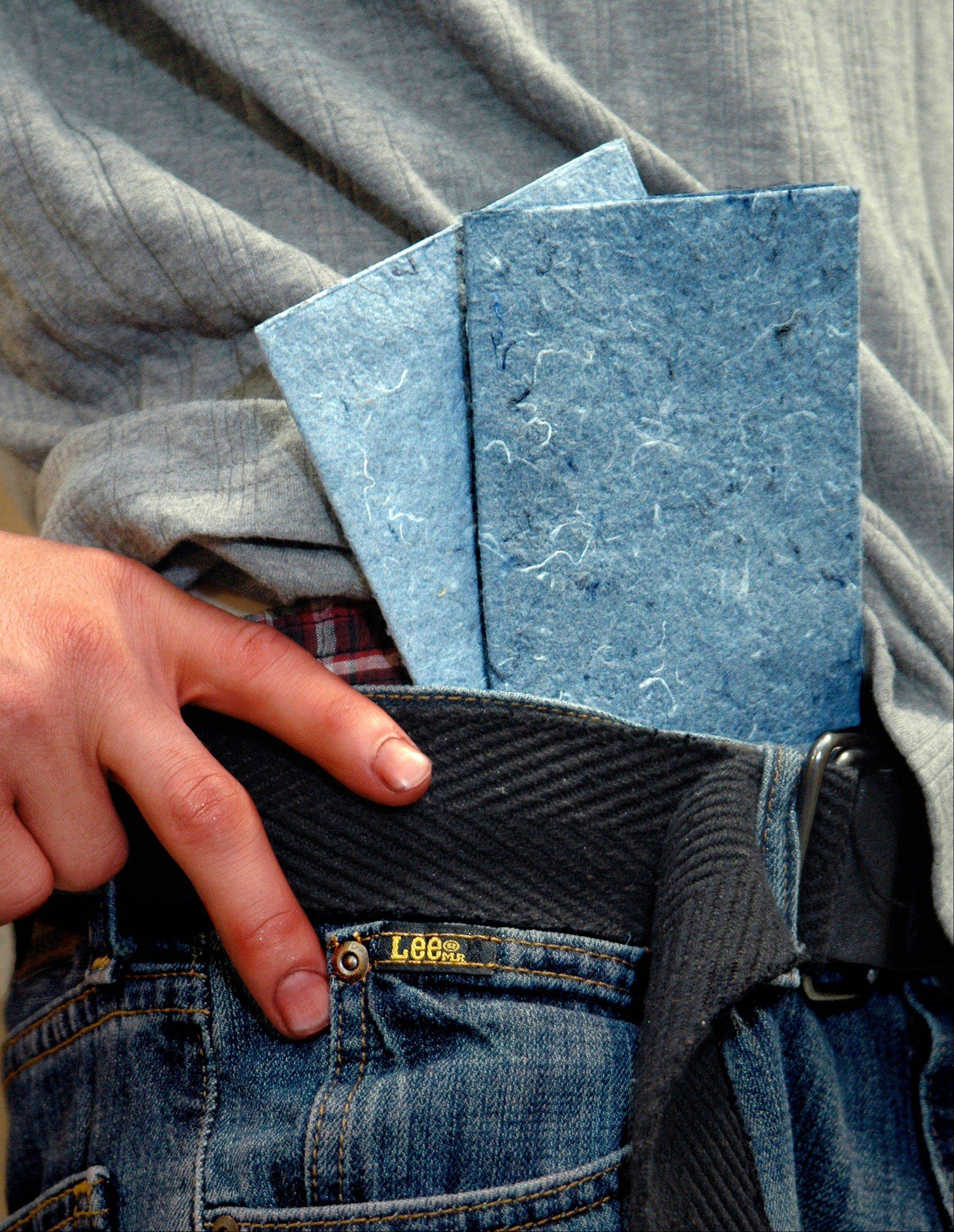 Recycled denim is turned into handmade greeting cards by workers with special needs at Paperworks Studio.