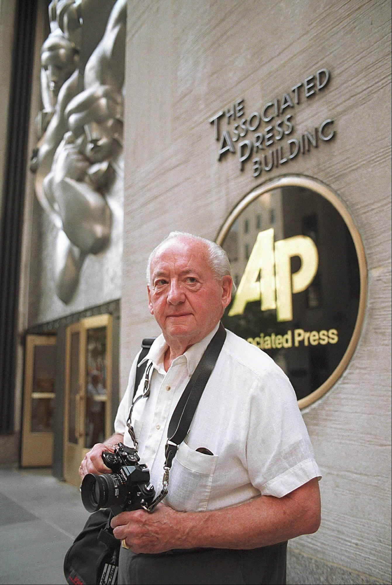 On Sept. 11, 2001, photographer Marty Lederhandler knew the real story was downtown. But he also knew that the trains weren�t going that way, and his 84-year-old legs wouldn�t carry him that far. �If there�s obstacles in your path, you try some other way,� he had said in an interview. �You go behind. You go in back. You go up high.� Lederhandler took the elevator to the 65th floor and the famed Rainbow Room at 30 Rockefeller Plaza, which he knew would offer a stunning view of the Empire State Building and the Twin Towers beyond, and began shooting. �The only other story that compares to this is D-Day,� said Lederhandler, who died in March 2010 at the age of 92.