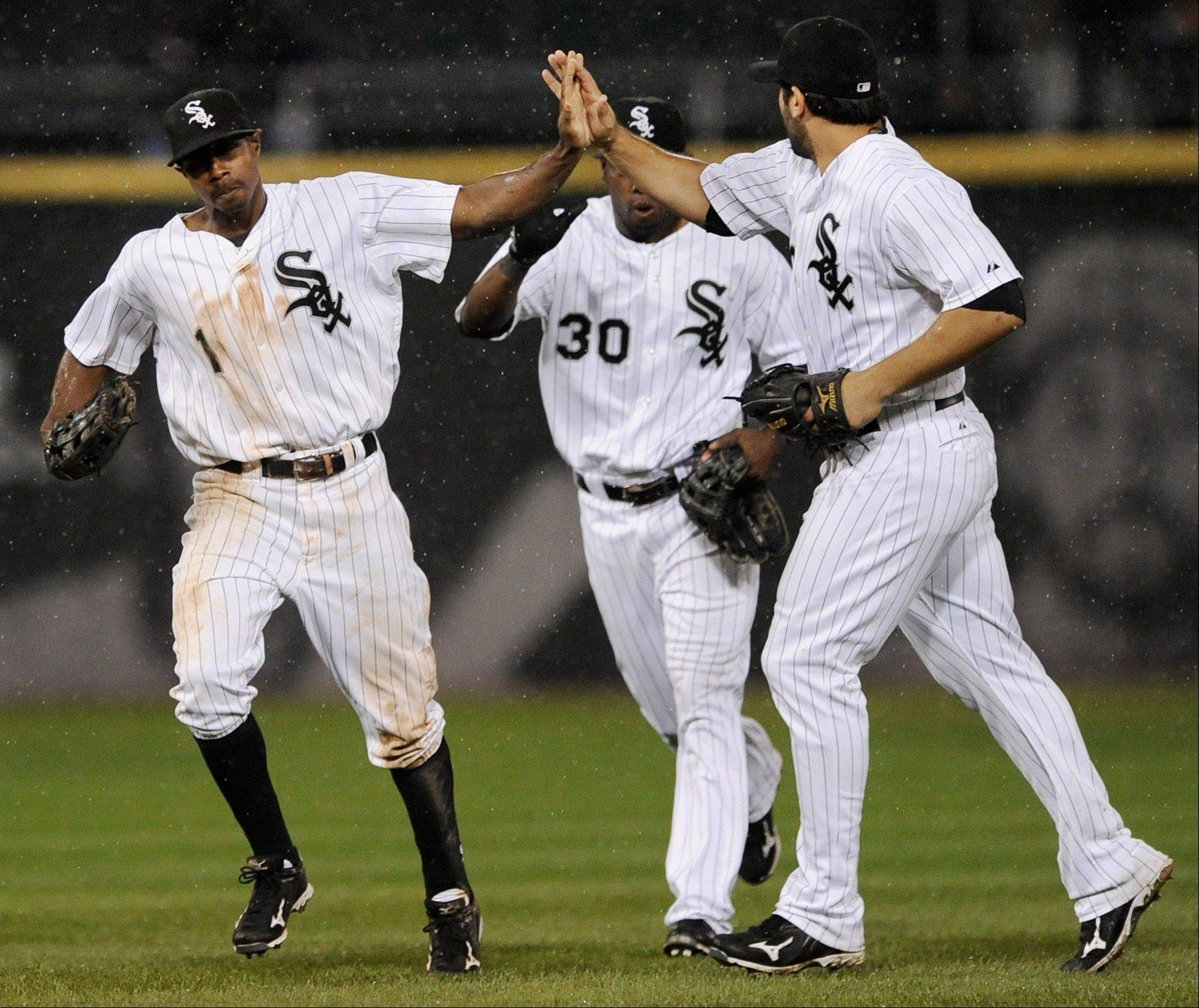 Juan Pierre left, Alejandro De Aza middle, and Carlos Quentin celebrate after defeating the Kansas City Royals 5-4 Saturday at U.S. Cellular Field.