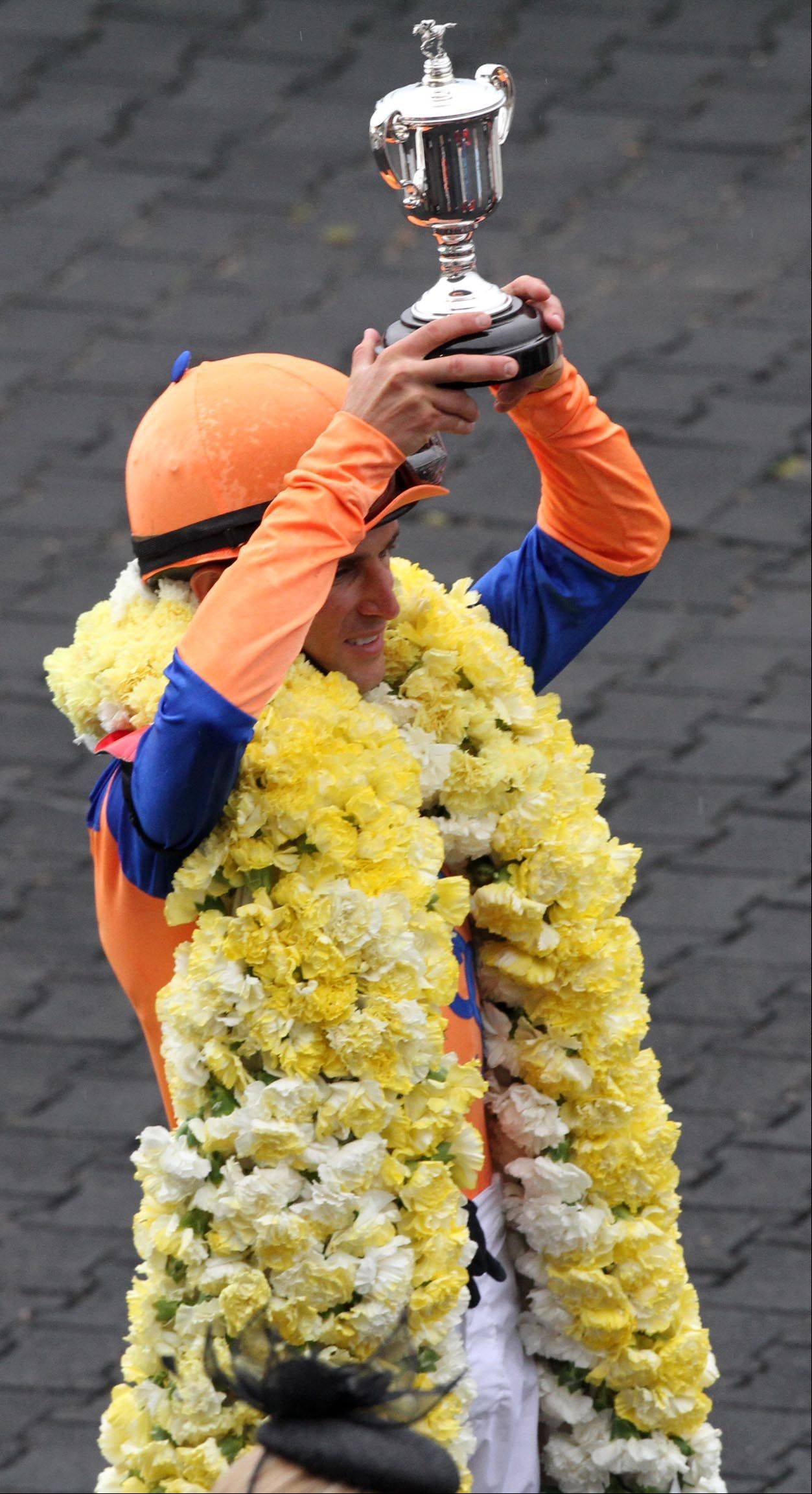 Ramon Dominguez celebrates after winning the Beverly D aboard Stacelita at Arlington Park on Saturday.