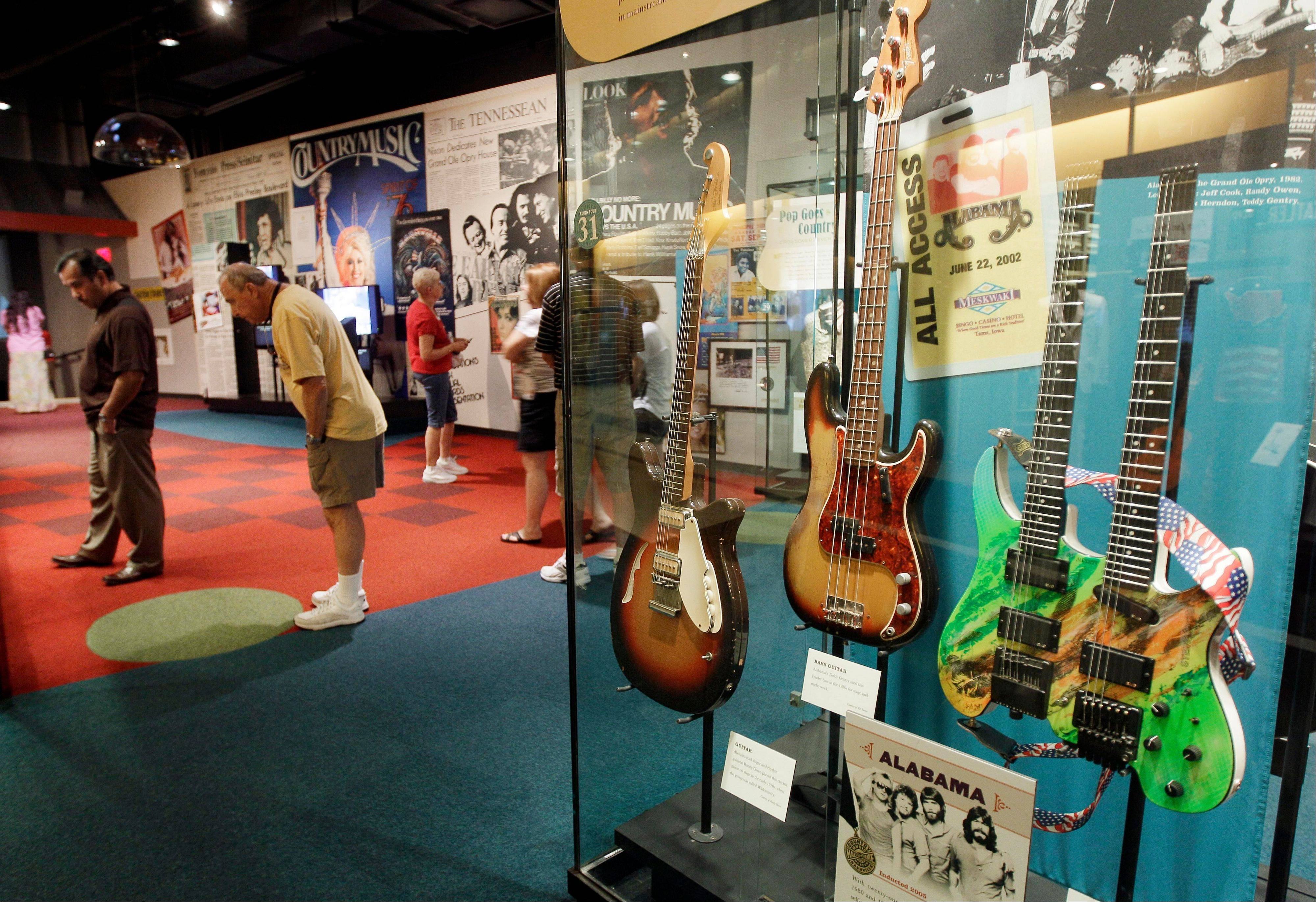 Guitars from the group Alabama are on display in the Country Music Hall of Fame and Museum in Nashville, Tenn.