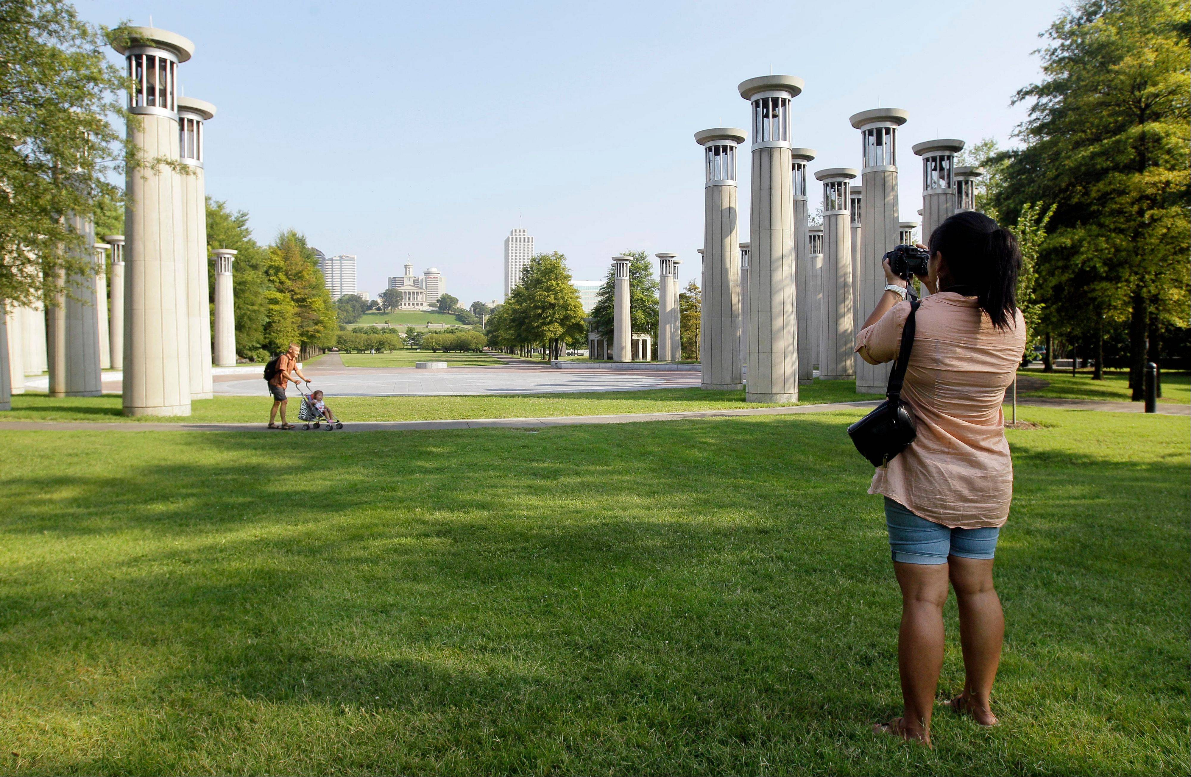 Cathy Bartnick, of Albuquerque, N.M., photographs the Bicentennial Capitol Mall State Park in Nashville, Tenn.