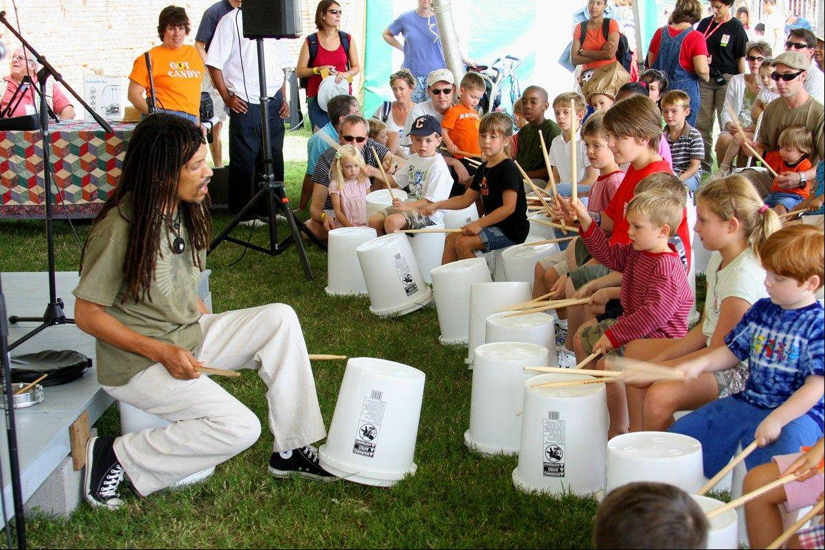 Ram Bhagat, of Drums No Guns, performs with young participants at the 2008 National Folk Festival in Richmond, Va. This year, the National Folk Festival will be in Nashville, Tenn.