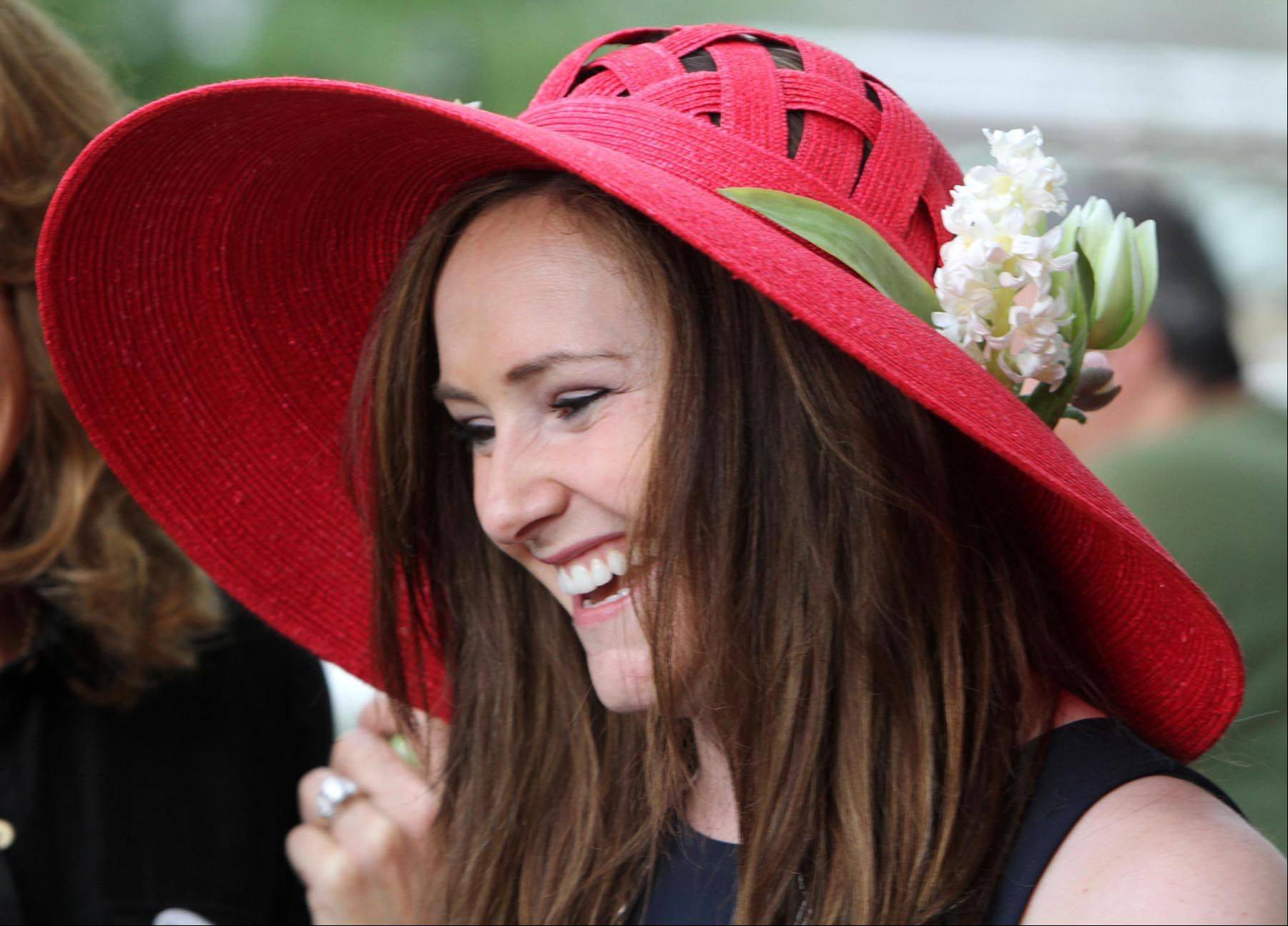 Cara McKeighan of Naperville wore a bright red hat while watching the Arlington Million at Arlington Park on Saturday.