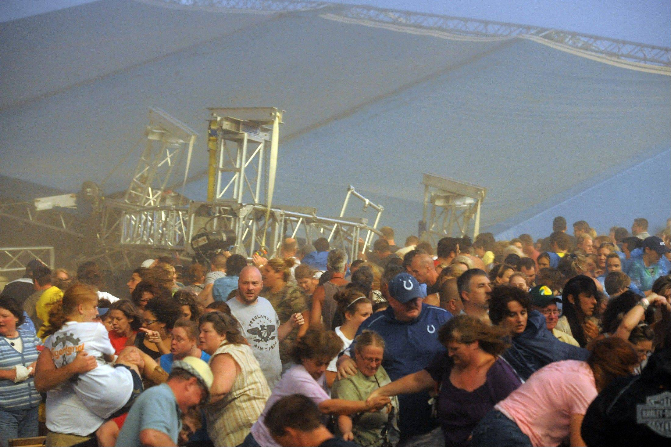 Fans waiting to see Sugarland run away after high winds blew the stage over Saturday at the Indiana State Fair Grandstands. About a dozen people are reported to have injuries after the stage collapsed.