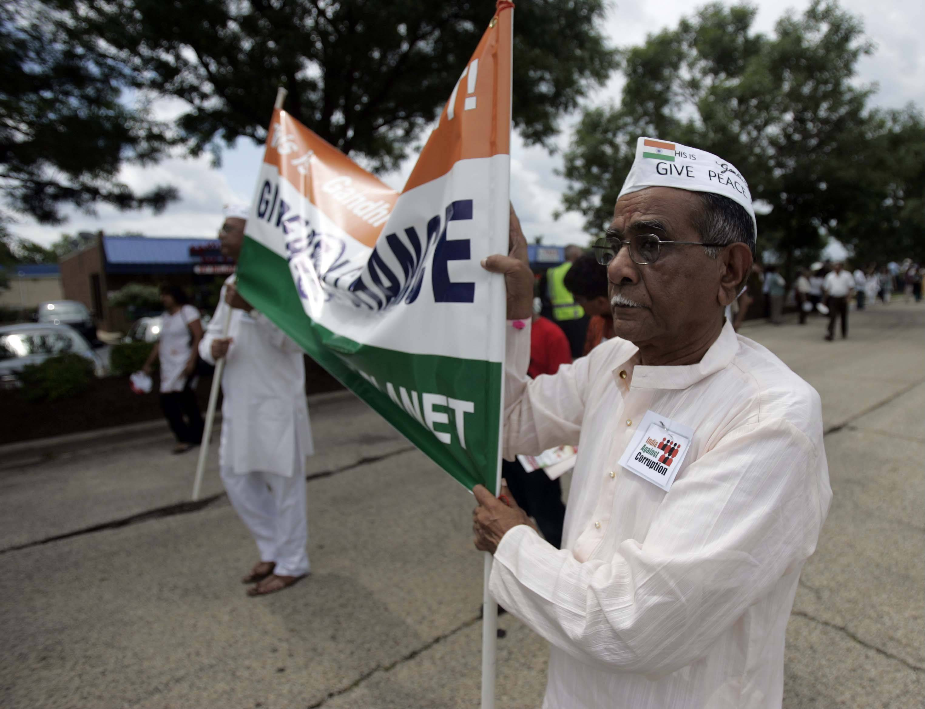 Sambha Malgewkav walks in the Chicago-based Federation of Indian Associations 65th India's Independence Day parade Saturday in Schaumburg.