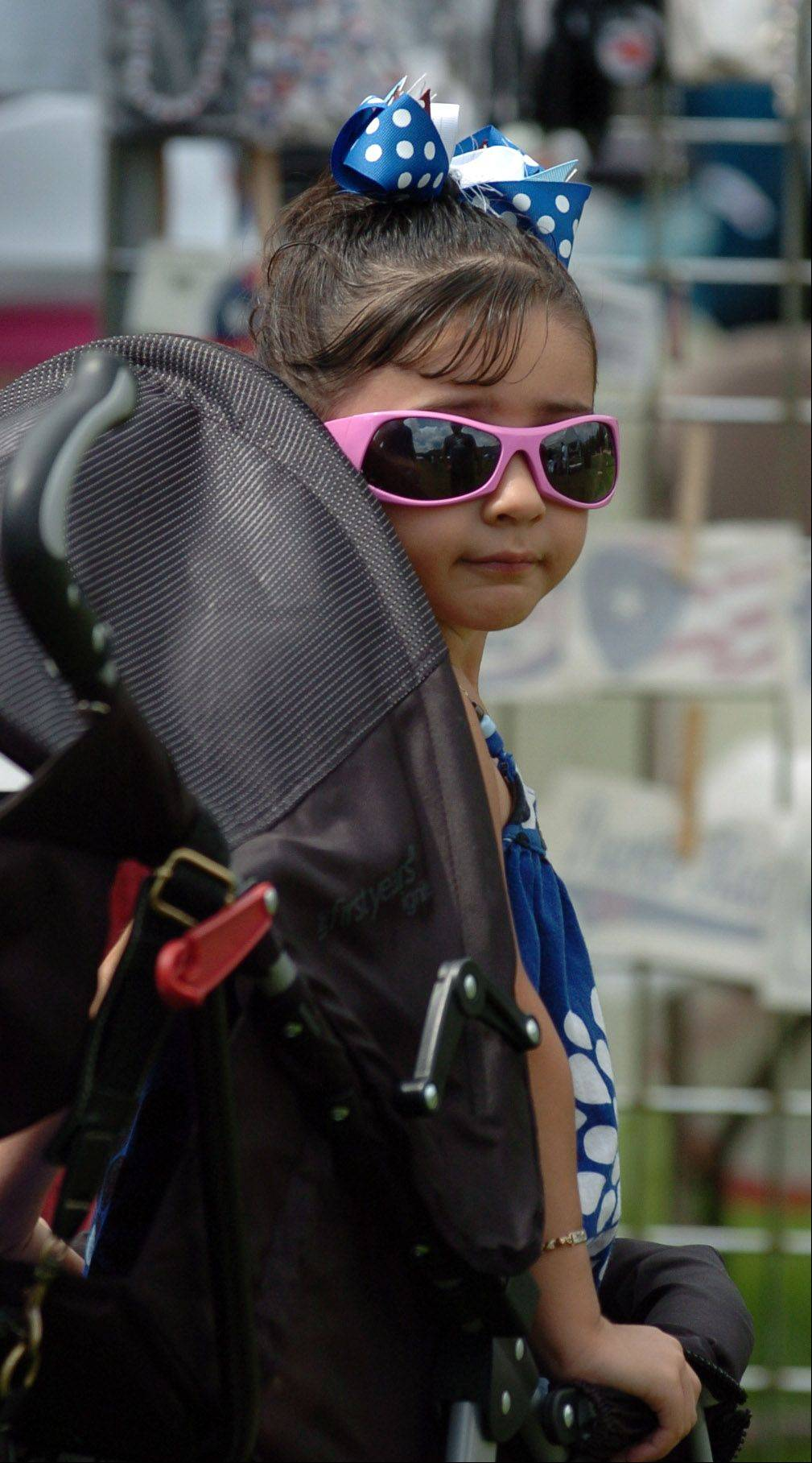 Alezandra Ramos of Aurora, 6, peeks out from her stroller at BoriquaFest.