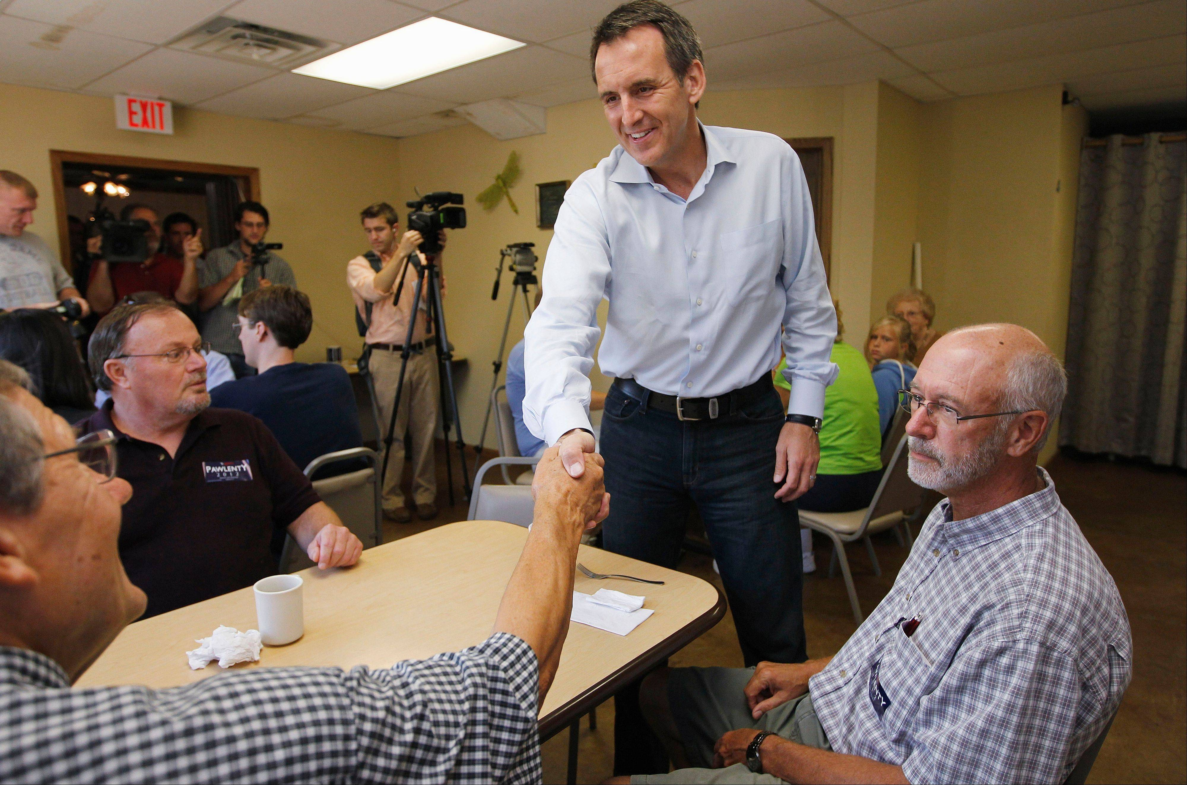 Former Minnesota Gov. Tim Pawlenty greets residents as he makes a campaign stop at Coffee Cup Cafe in Sully, Iowa, on Tuesday.