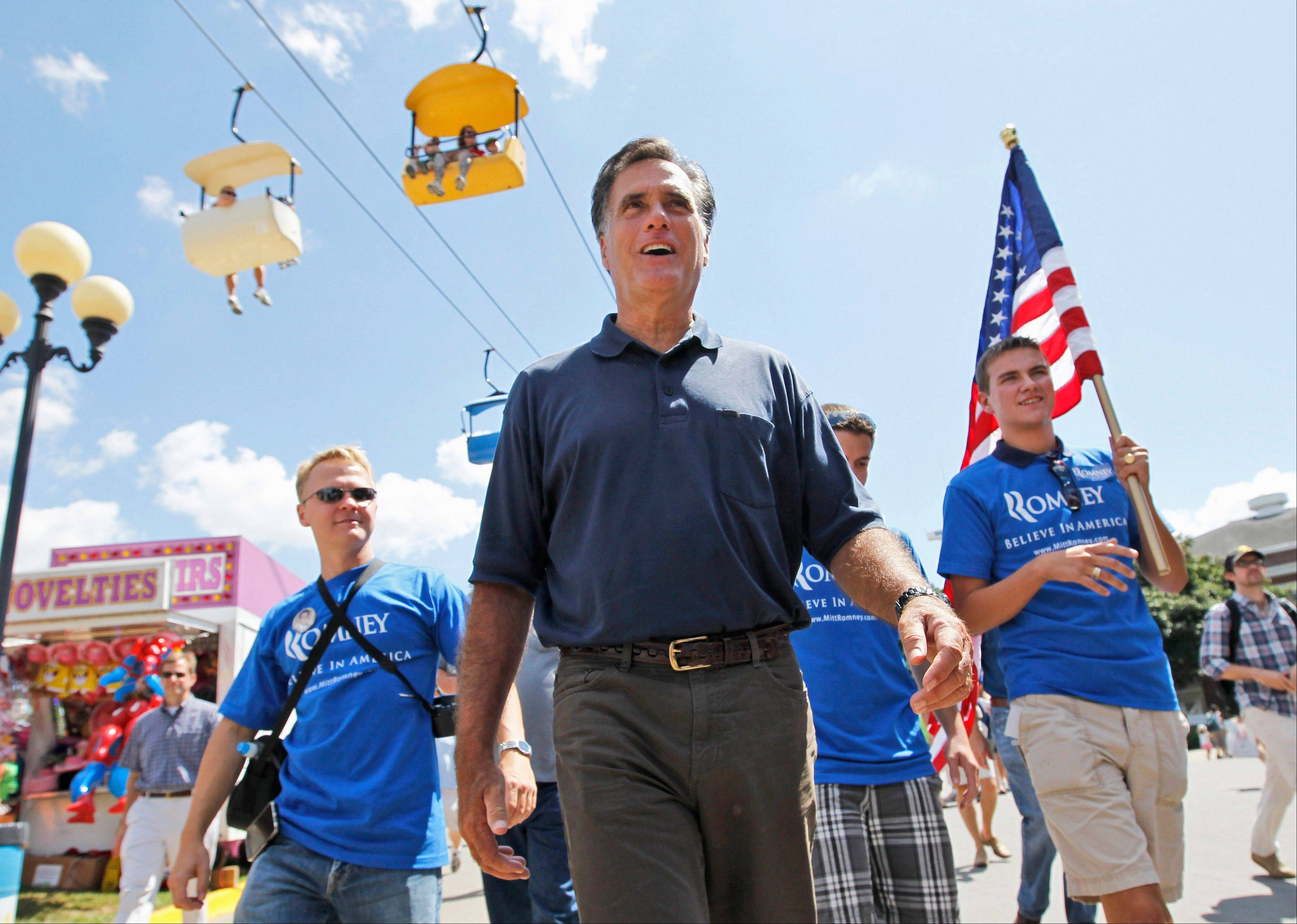 Former Massachusetts Gov. Mitt Romney campaigns at the Iowa State Fair in Des Moines on Thursday.