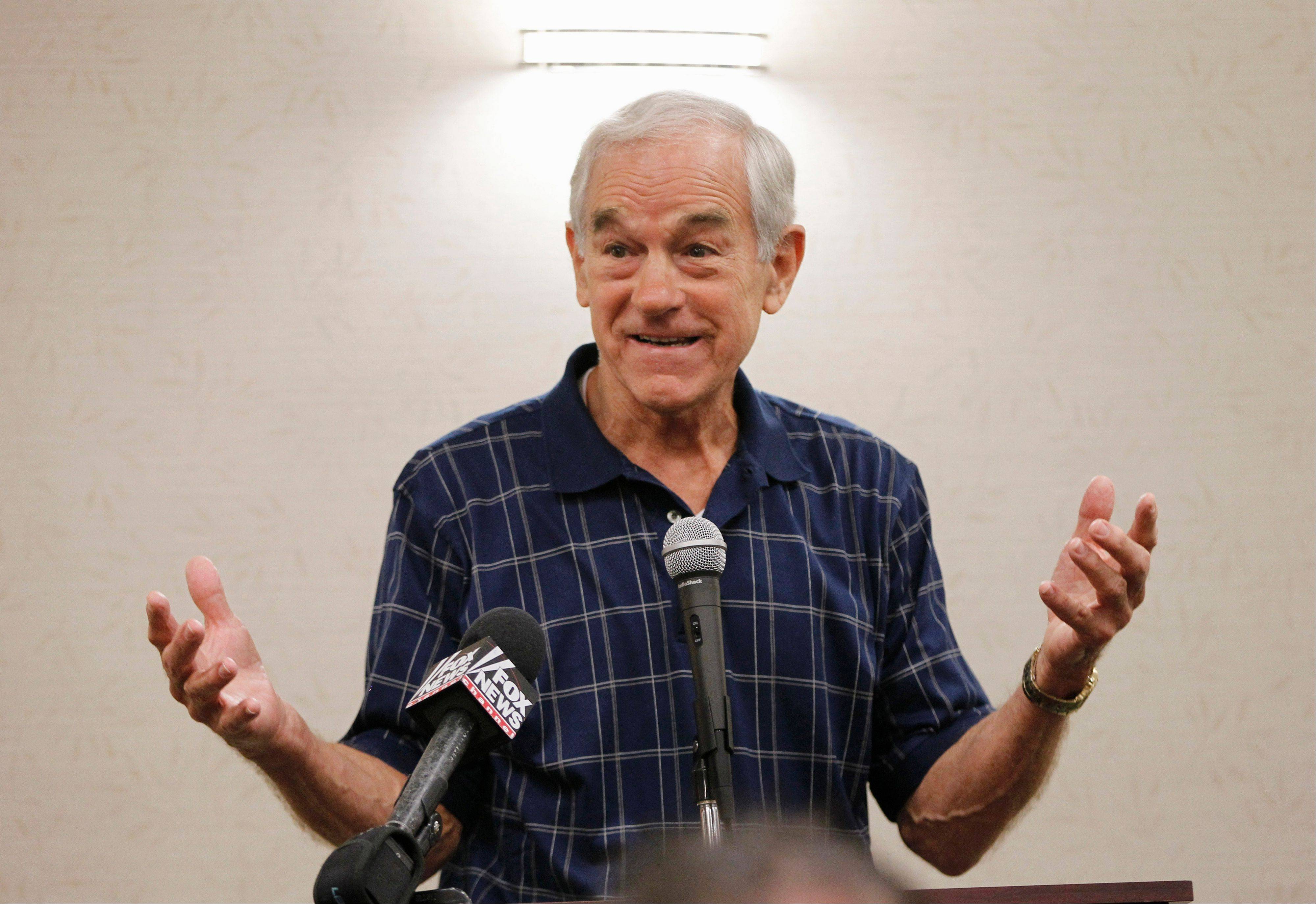Texas Congressman Ron Paul speaks at a campaign event at a hotel in Ames, Iowa, on Thursday.