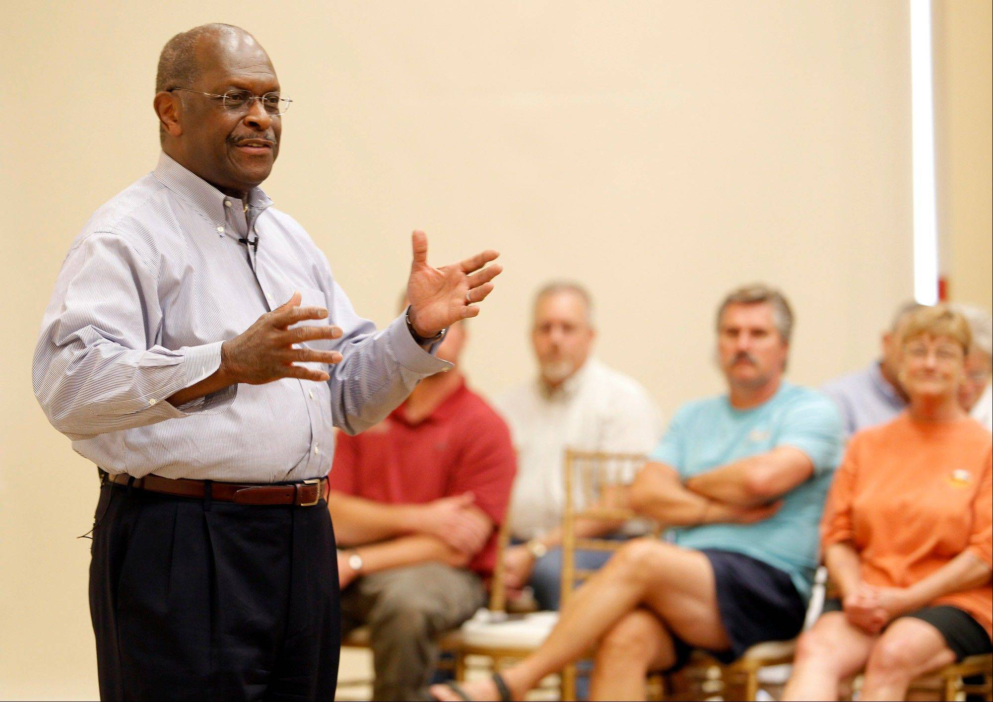 Republican presidential candidate Herman Cain speaks to supporters and others at the PIPAC Center in Cedar Falls, Iowa, on Tuesday.
