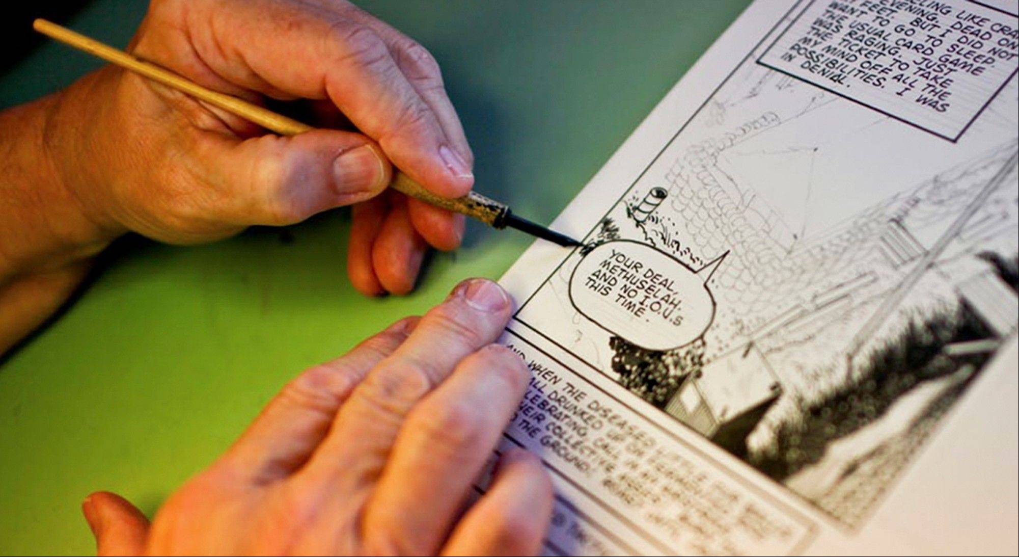 "Don Lomax, 66, uses a fountain pen as he draws his comic ""Vietnam Journal"" at his home in Galesburg, Ill. Lomax bases the stories in his comics on his experience in the Vietnam War."
