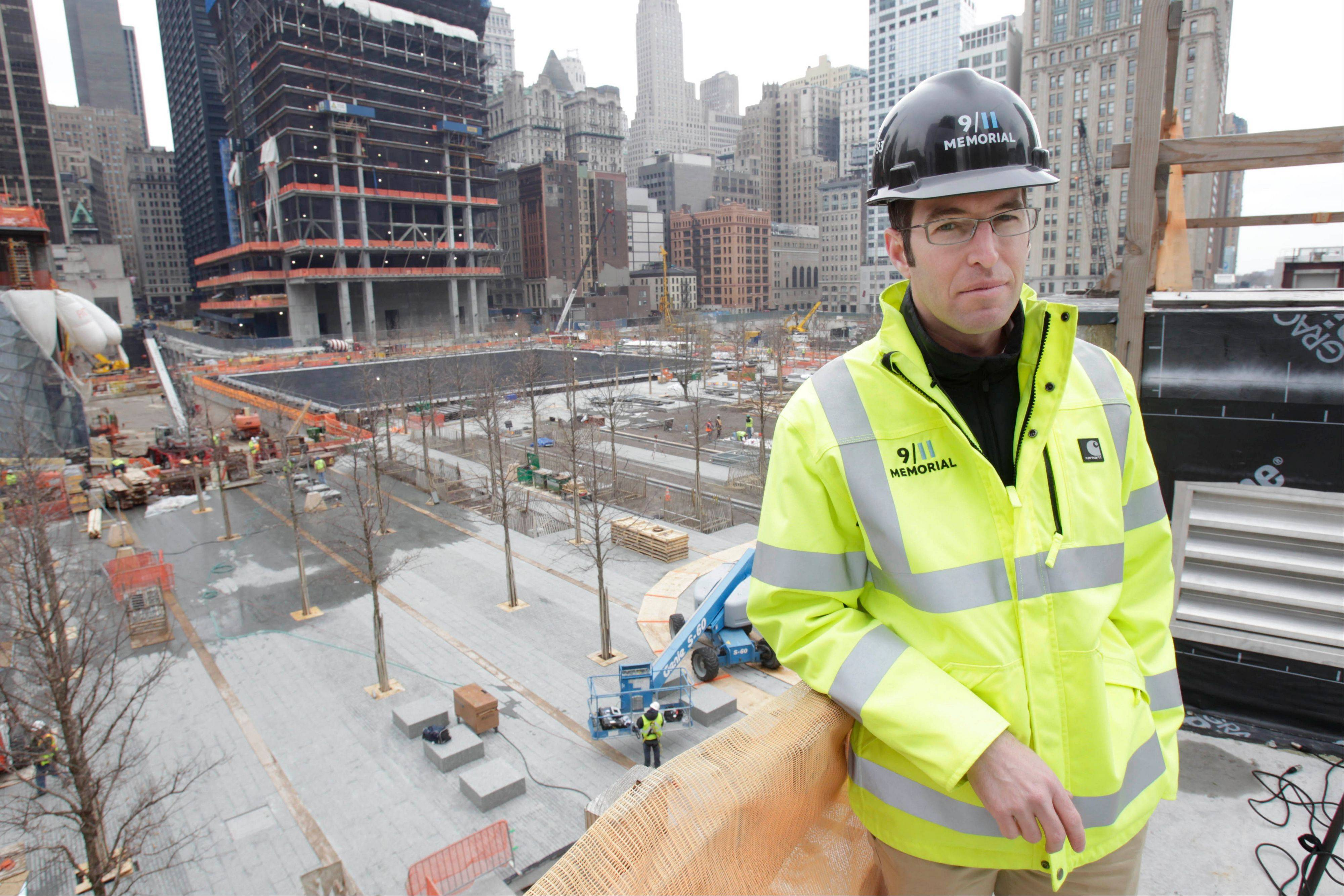 Michael Arad, an architect of the 9/11 memorial at ground zero, poses for a picture in front of the ongoing construction at ground zero in New York in April