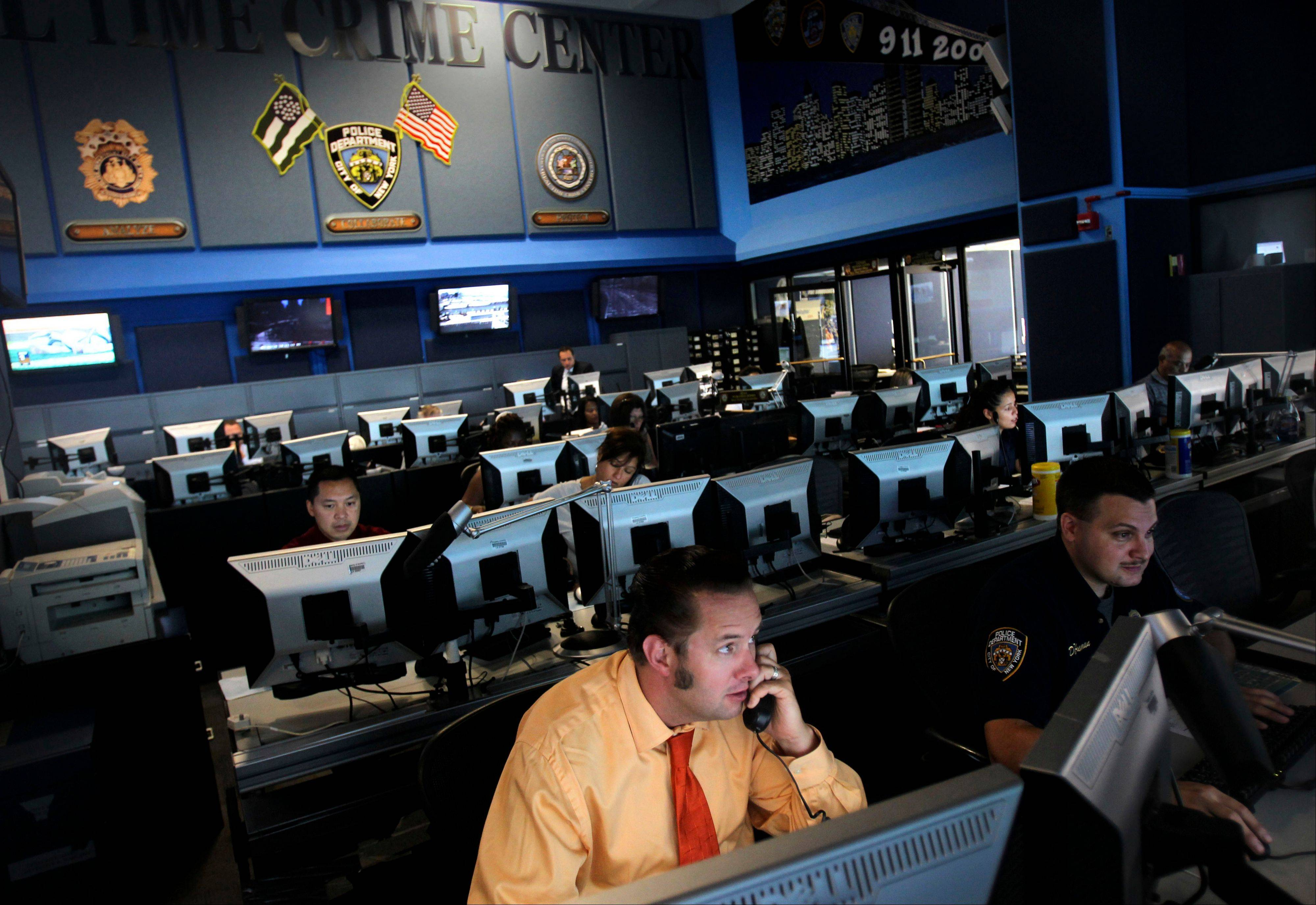 Employees work inside the Real Time Crime Center at police headquarters in New York. A decade after the Sept. 11 terror attacks, New York City emergency agencies are better trained and better equipped to communicate in a disaster, but first responders in cities around the country say the progress is not good enough. A national network is needed where police and fire departments can talk to each other and share video and other critical data, they say.