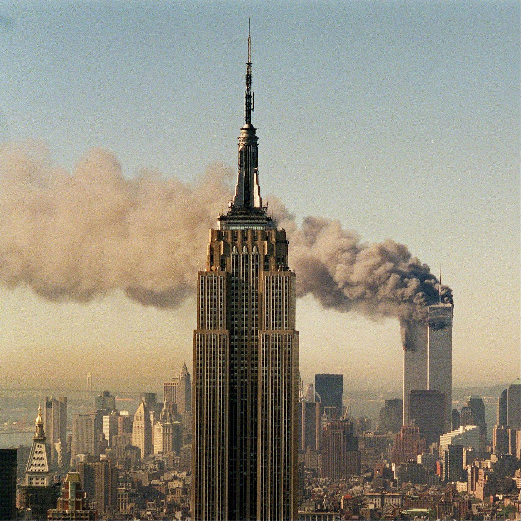 Marty Lederhandler shot this photo of the twin towers of the World Trade Center burning behind the Empire State Building in New York on Sept. 11, 2001.