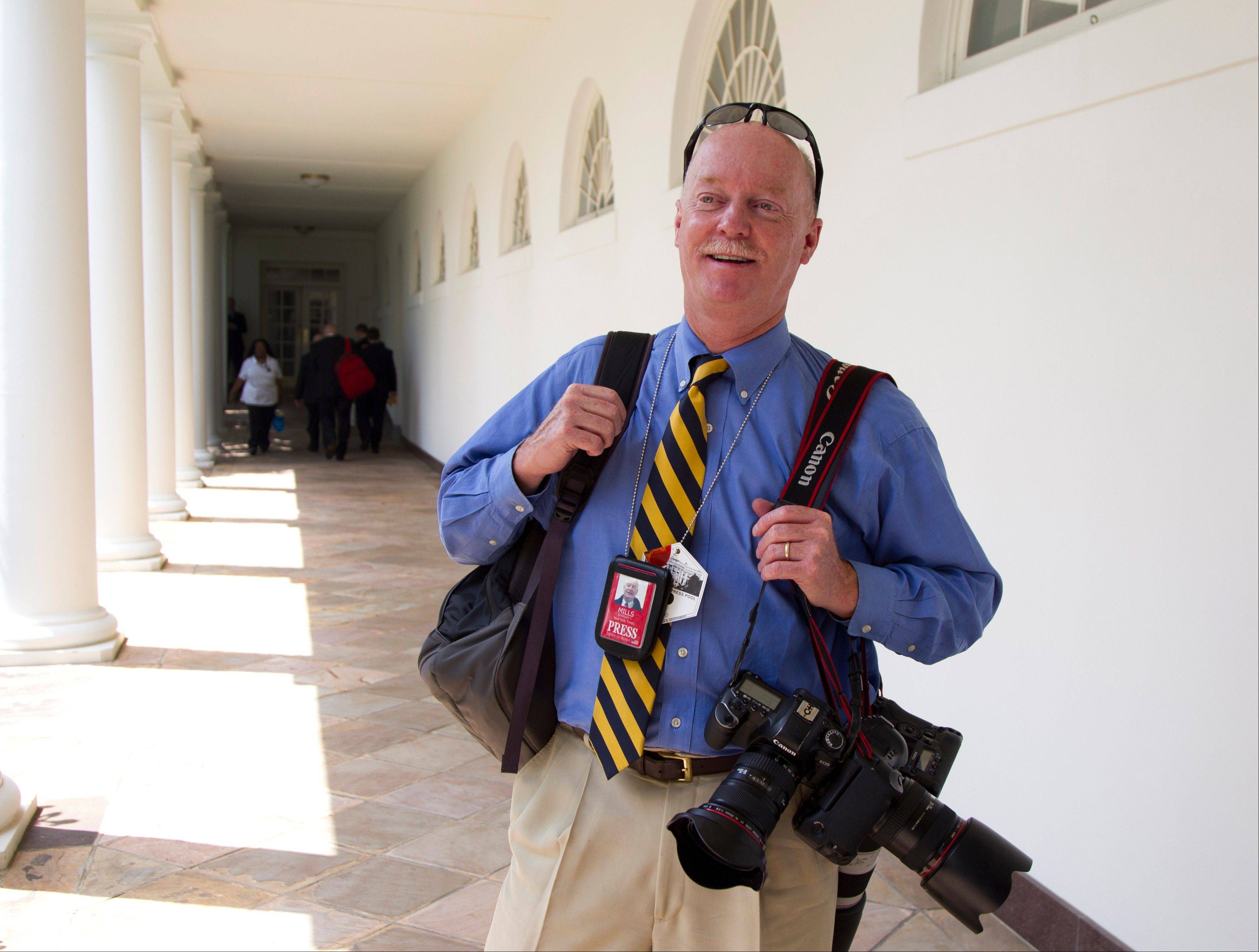 "For former Associated Press photographer Doug Mills, Sept. 11, 2001, started out like most days covering President George W. Bush on the road. It was only after Mills and other journalists boarded Air Force One and began watching the live CNN news feed that the full import of that morning's schoolroom event came into focus. A visit that had started out as a routine ""photo-op,"" was now a moment in history."