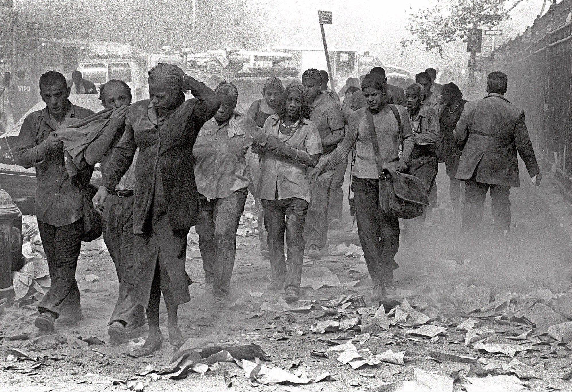 Gulnara Samoilova shot this photo of people covered in dust walking over debris near the World Trade Center in New York on Sept. 11, 2001.