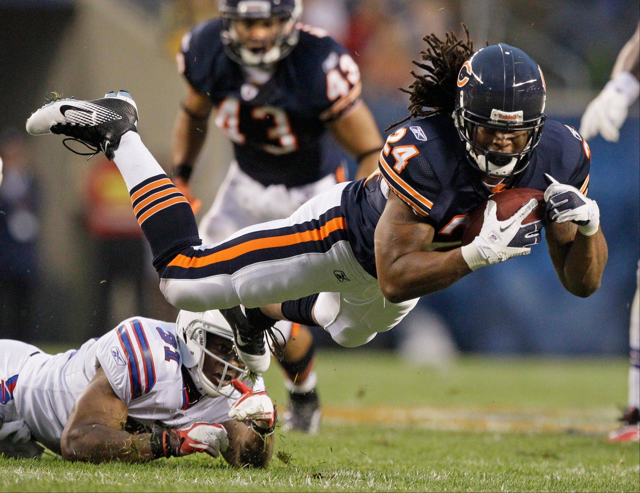 Bills safety Jairus Byrd trips up Bears running back Marion Barber in the first half of their preseason game at Soldier Field on Saturday.