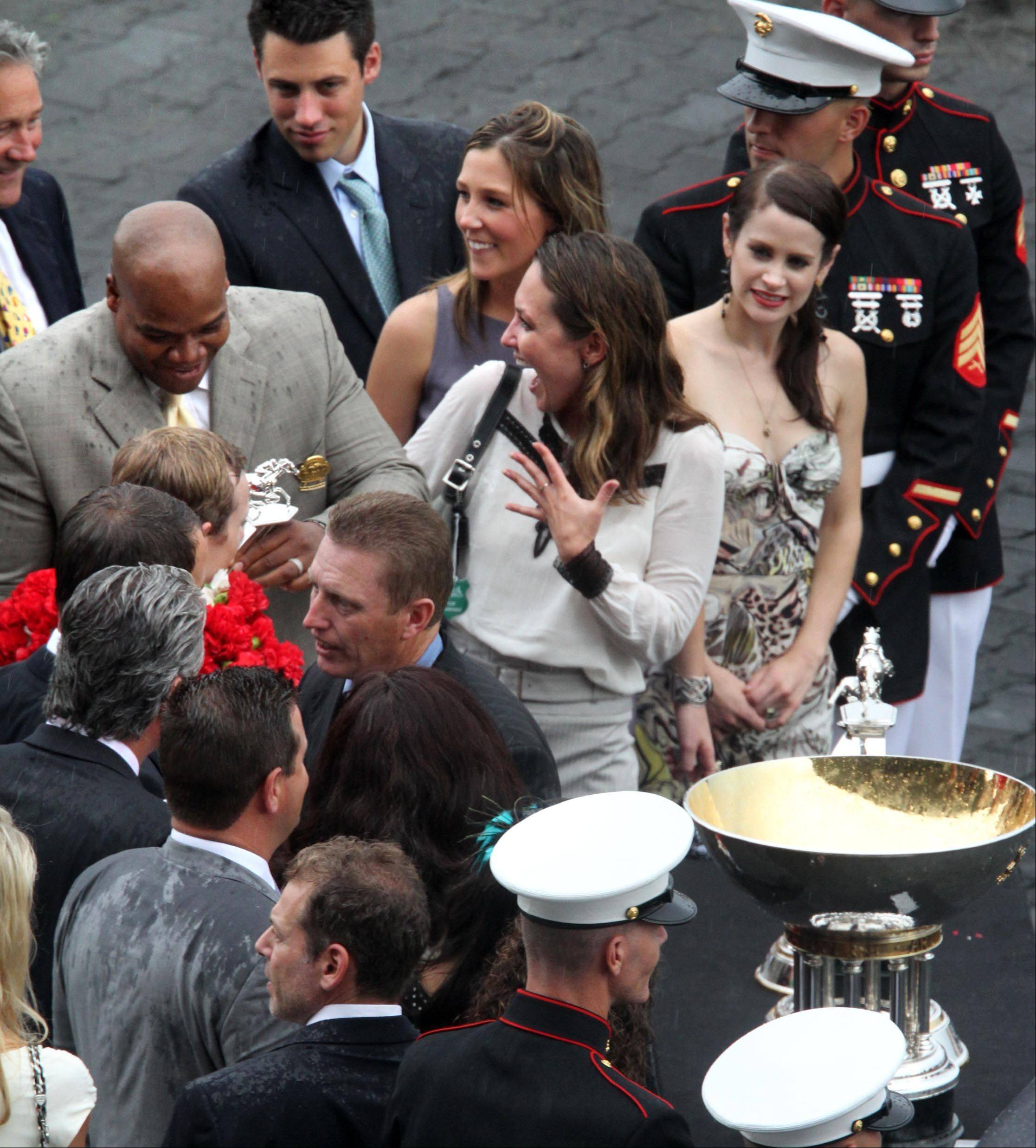 Former White Sox slugger Frank Thomas helps celebrate in the Arlington Million winners circle at Arlington Park on Saturday.