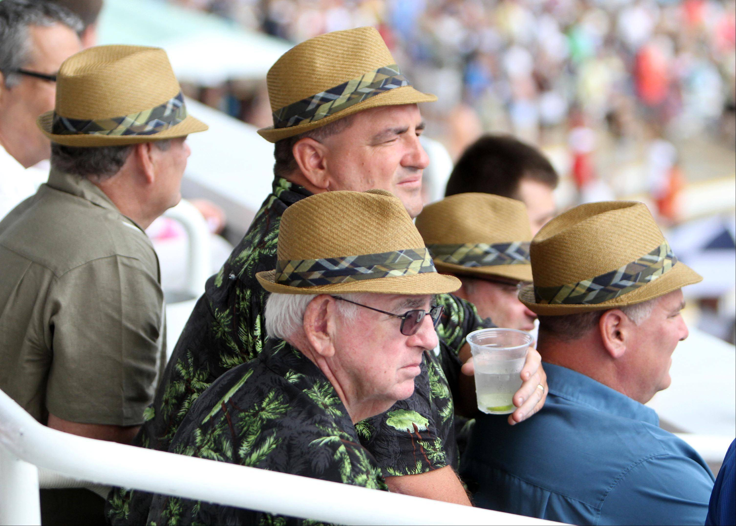 A group of men from Detroit all wore the same fedora hat to the Arlington Million at Arlington Park on Saturday.